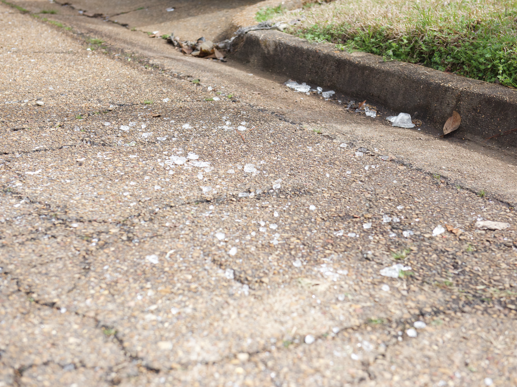 In this February 18, 2019, broken glass in front of a Clinton home, where four were found dead on Saturday, Feb. 16, 2019, after a long standoff with law enforcement.  A suspect, Nam Quang Le, 34, was shot and later died at a hospital.