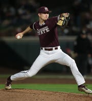 Mississippi State's Peyton Plumlee (13) releases a pitch. Mississippi State opened the 2019 baseball season against Youngstown State on Friday, February 15, 2019. Photo by Keith Warren