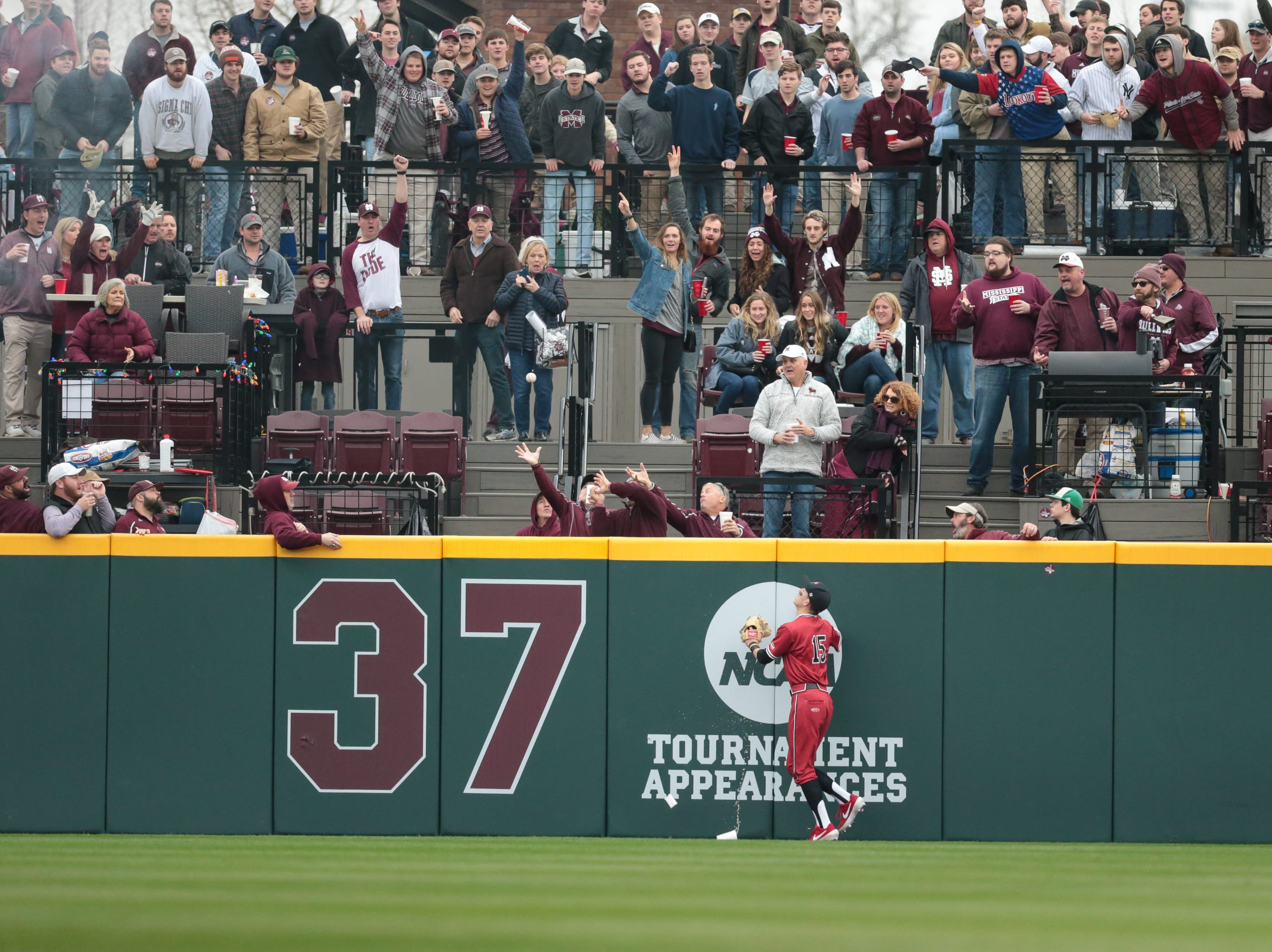 MSU fans try to catch a home run ball as Youngstown State's Web Charles (15) looks on. Mississippi State played Youngstown State on Saturday, February 16, 2019. Photo by Keith Warren
