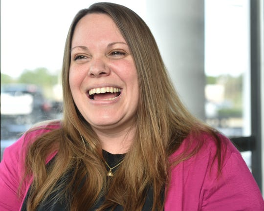 "Trisha Gibson is all smiles following an appointment to have embryos implanted, Monday, Feb. 18, 2019 in Madison, Miss. ""I just really, really think a lot of Dr. Parry,""."