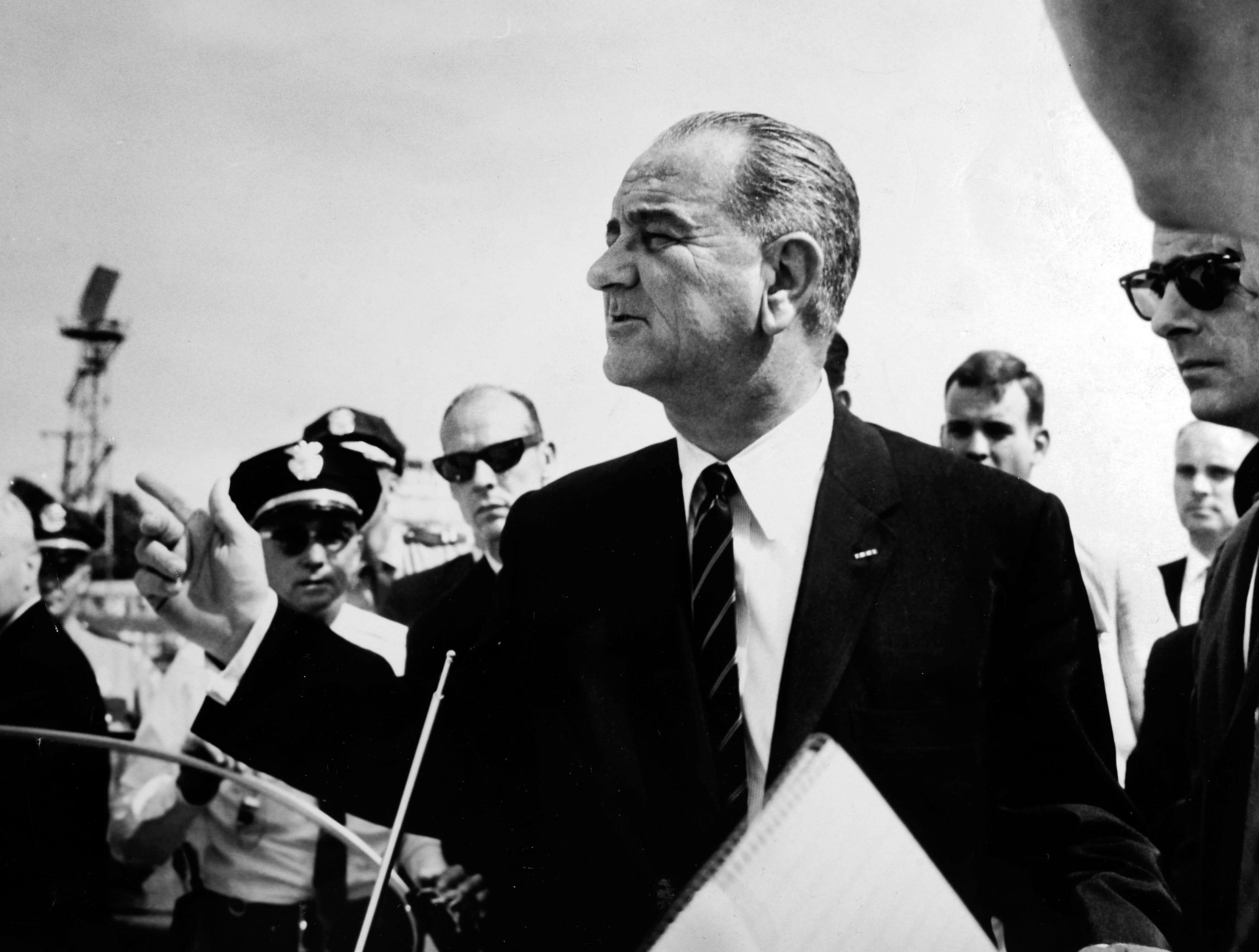 In a May 7, 1964 photograph, President Lyndon B. Johnson arrives at Municipal Airport.