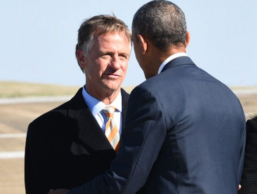 Gov. Bill Haslam, left, greets President Barack Obama Friday, Jan. 9, 2014, at McGhee Tyson Air National Guard Base. Obama is visiting the area to announce a new national education initiative at Pellissippi State Community College, as well as an announcement of a private public partnership in manufacturing innovation at a high-tech production facility in Clinton. (MICHAEL PATRICK/NEWS SENTINEL)