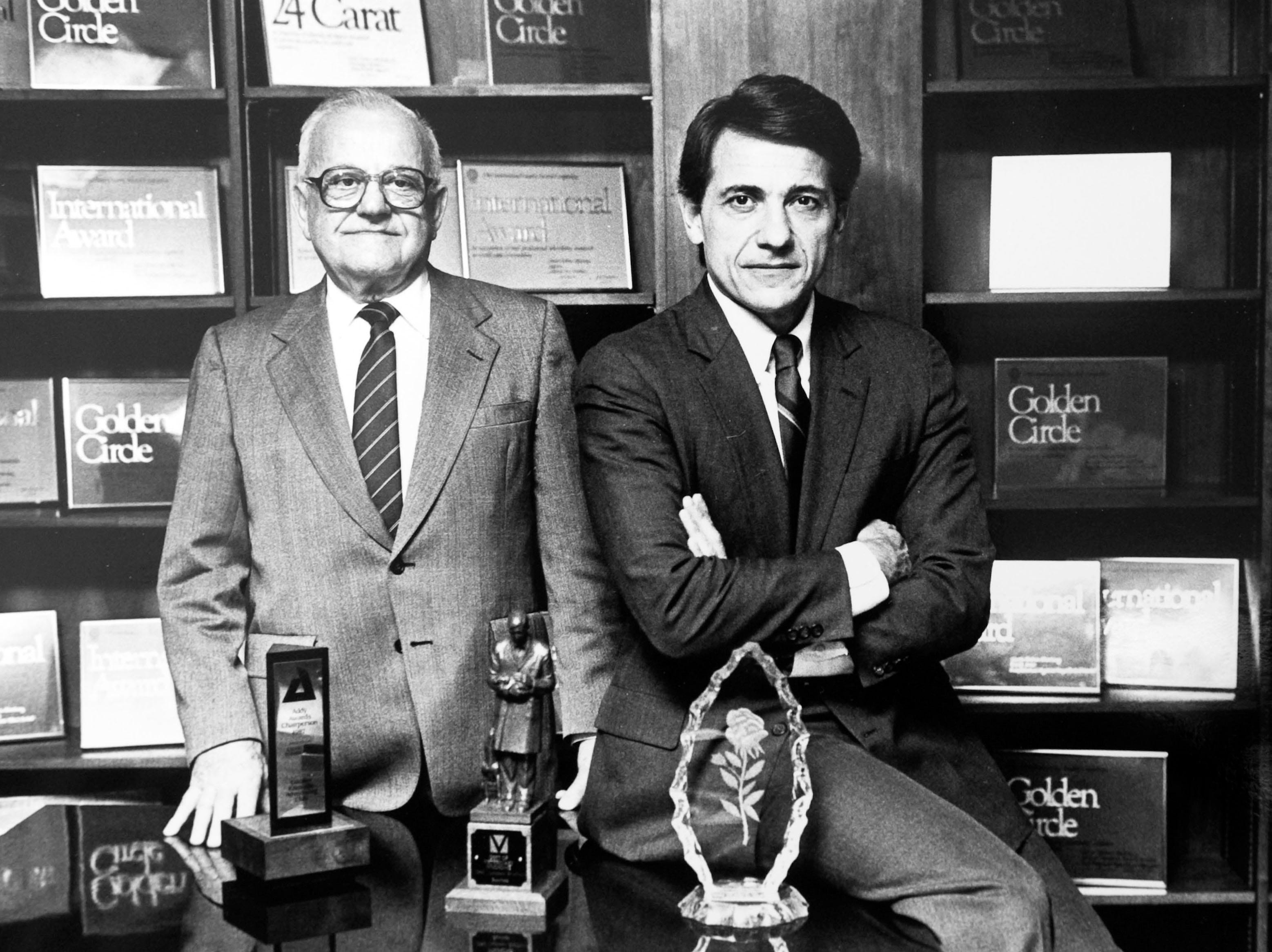 In this photograph dated to 1984, Charles Tombras Sr., left, founder of The Tombras Group is pictured with his son Charles Tombras Jr. at their offices on Concord St.
