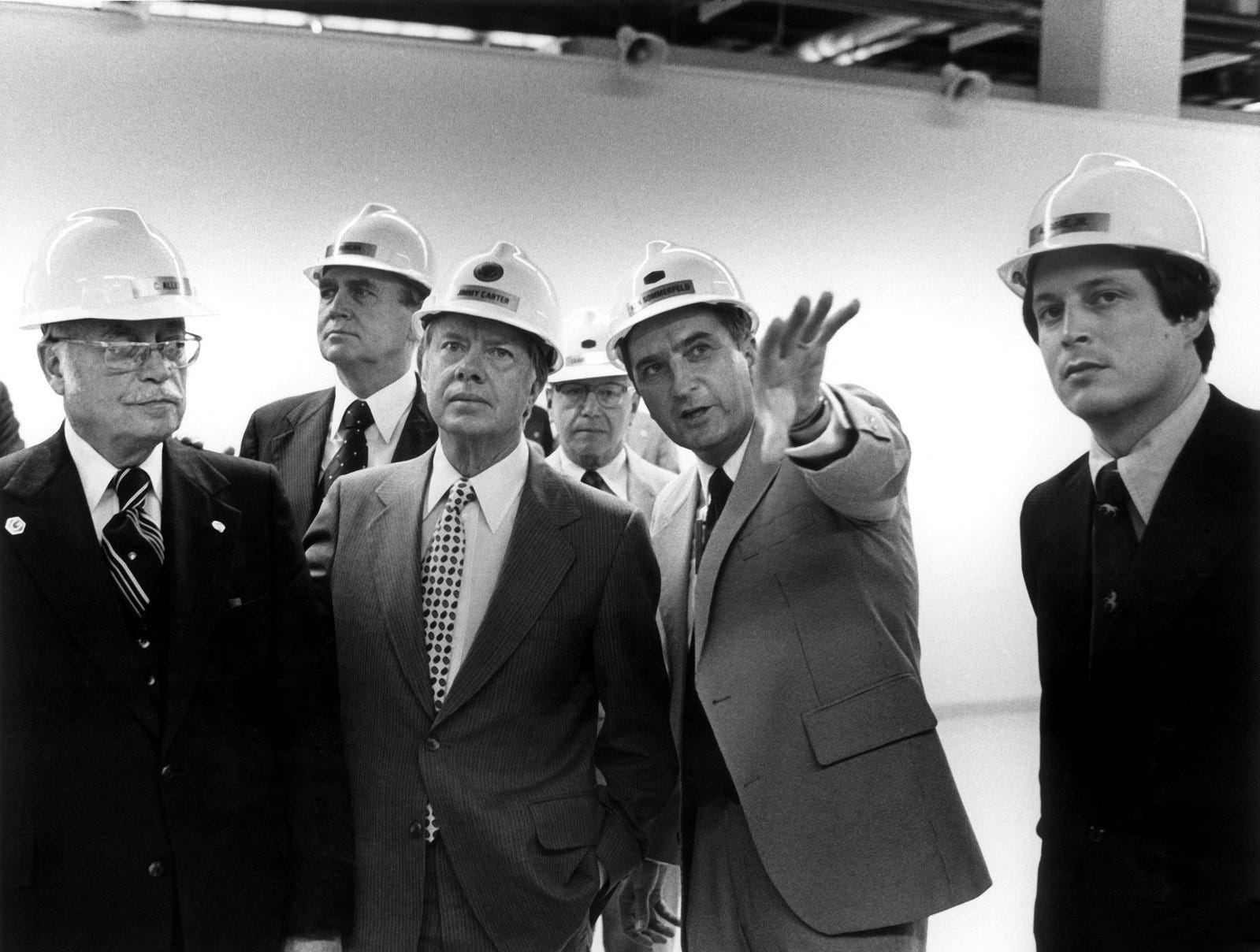 President Jimmy Carter visits Oak Ridge on May 22, 1978, accompanied by U.S. Rep. Al Gore, far right. Talking to the President is Union Carbide executive Ken Sommerfeld. (Department of Energy)
