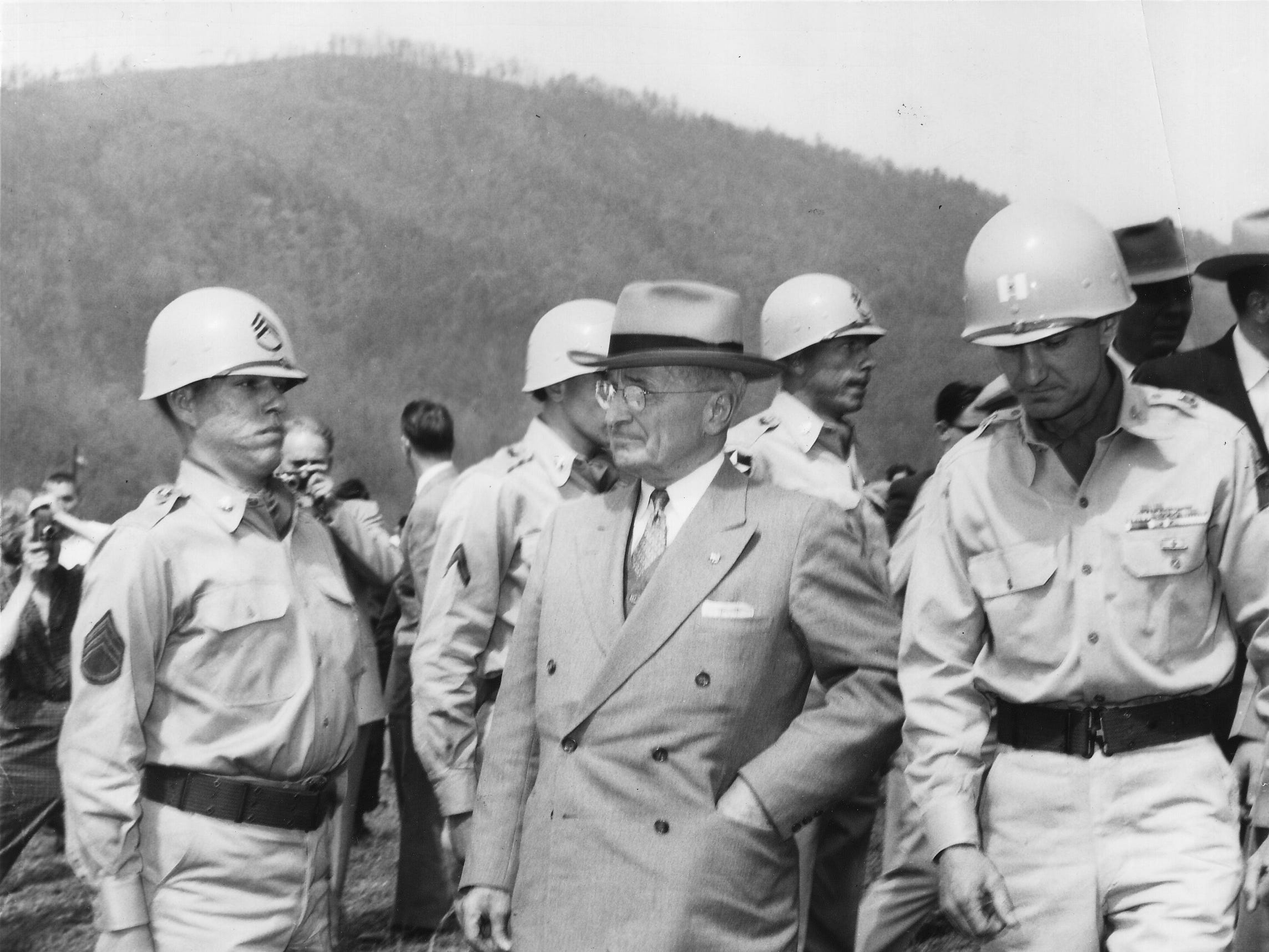 Former President Harry S. Truman is escorted by National Guardsmen during the second annual Cosby Ramp Festival on April 24, 1955.