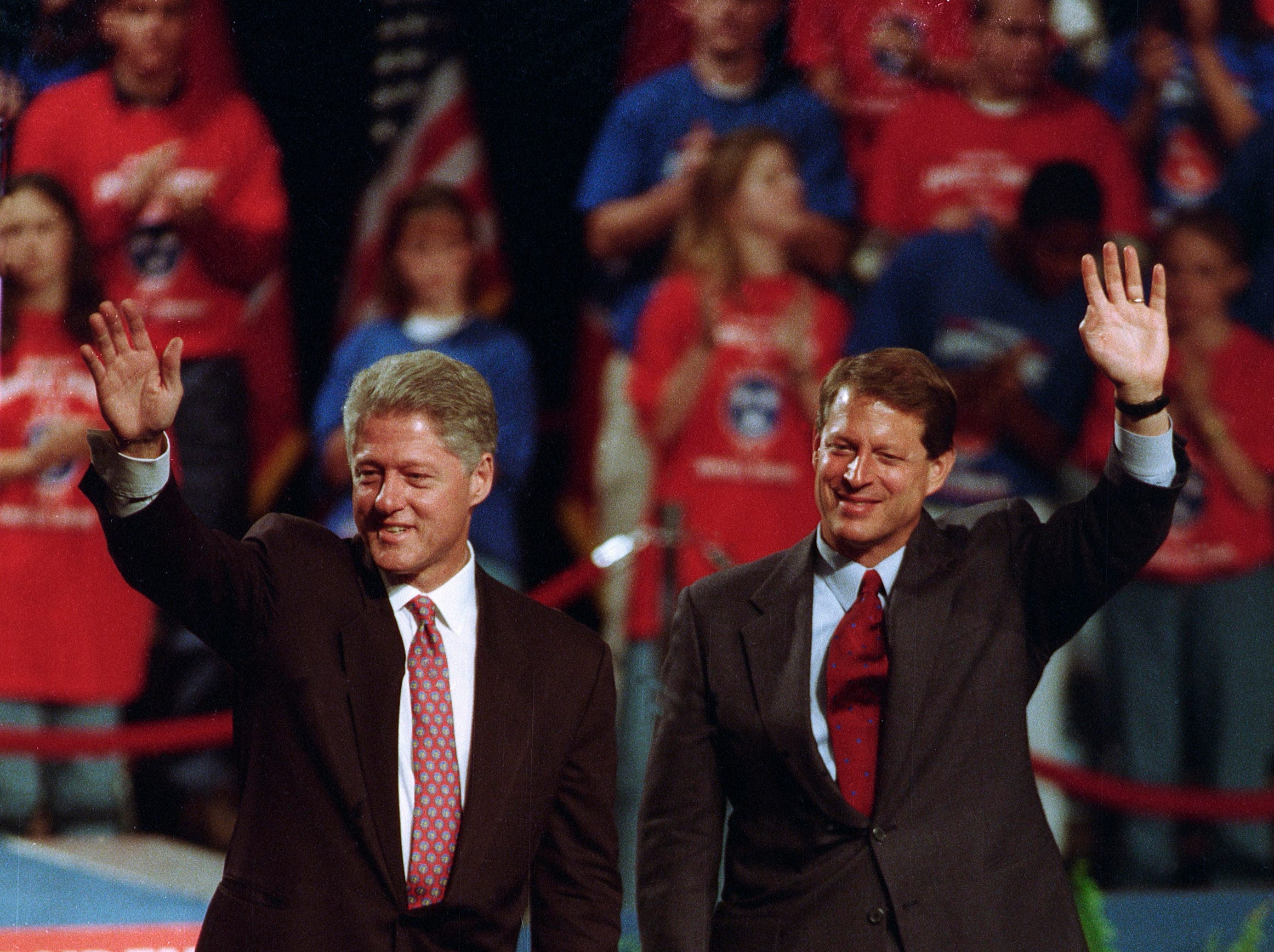 """In an Oct. 10, 1996, photograph, President Bill Clinton, left, and Vice President Al Gore greet supporters during a campaign stop at the Knoxville Civic Auditorium. Clinton announced a plan to bridge the """"digital divide"""" among the nation's school children by providing an Internet connection in every classroom. (Paul Efird/News Sentinel)"""