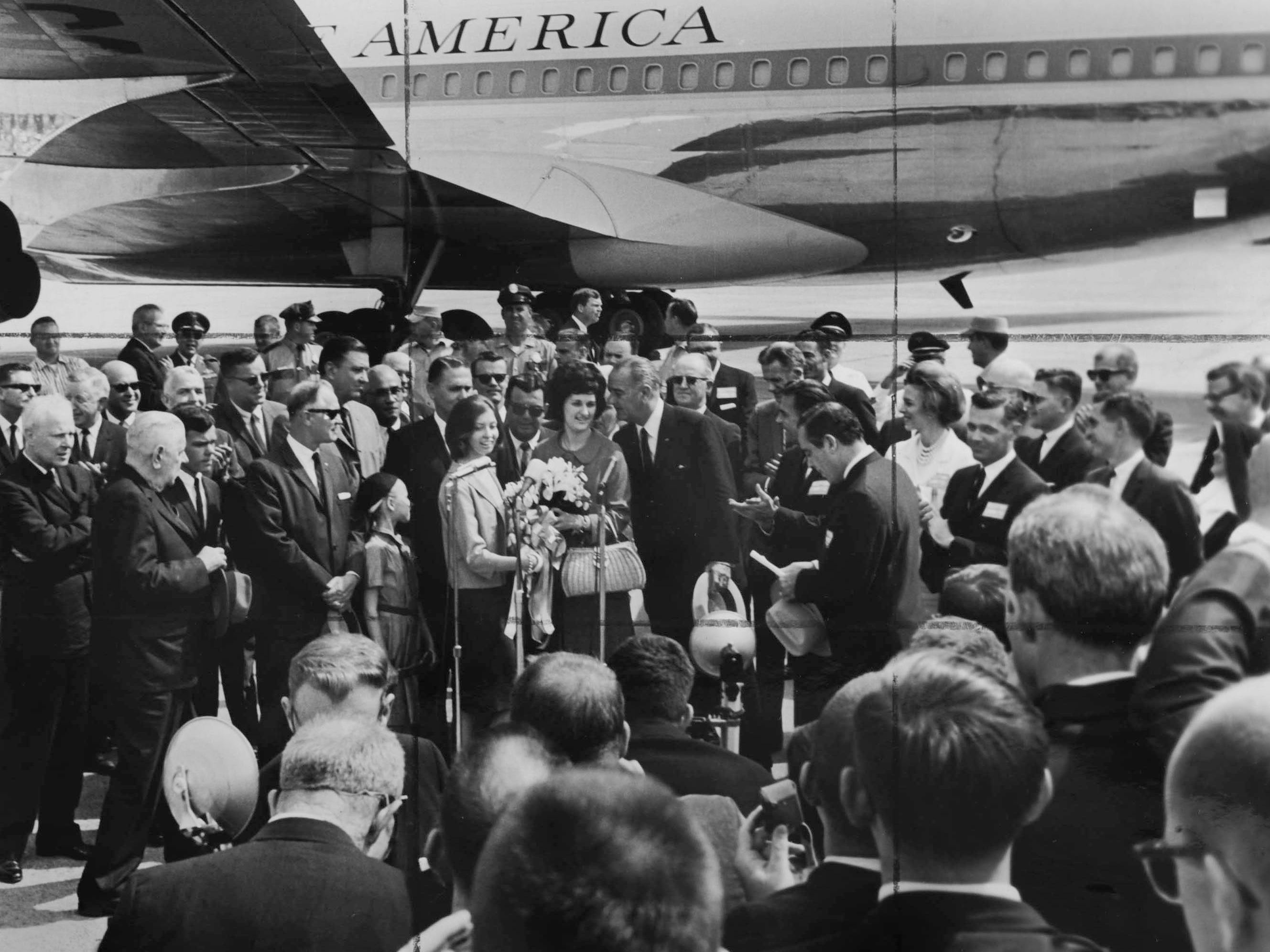 In a May 7, 1964 photograph, President Lyndon B. Johnson and his daughter, Lynda Bird, are welcomed at Municipal Airport.