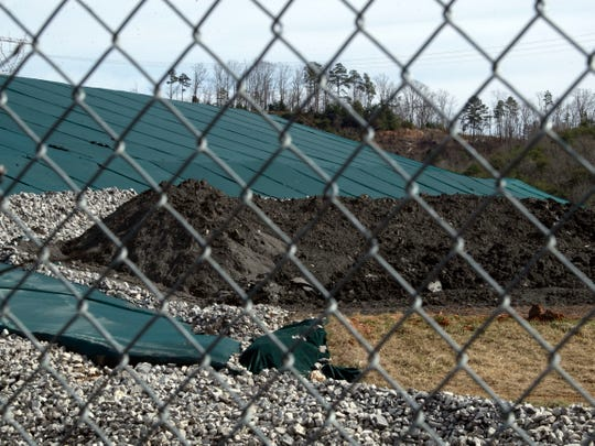 Coal ash mounds can been seen through the fencing at Kids Palace Playground in Clinton, TN on Wednesday, February 13, 2019.