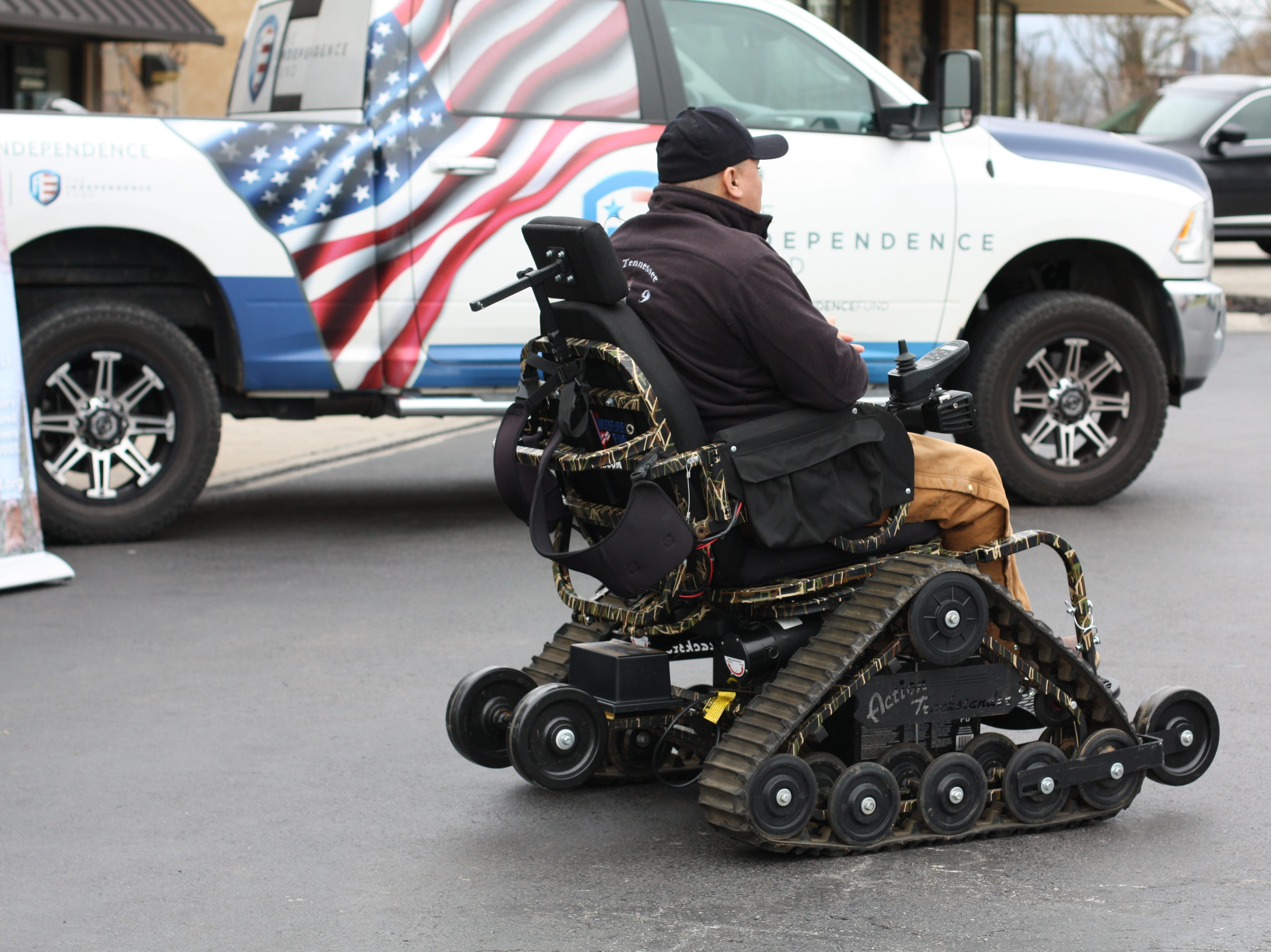 "Dameon Berry demonstrates the all-terrain wheelchair on Feb. 16, 2019. ""We are one of the local tire businesses of East Tennessee Local Tire Distributors, who are sponsoring the presentation,"" said Ron Bradley of Halls Service Center Tire Pros. ""The Independence Fund was looking for a recipient and we realized the right person was right under our nose, living just 20 minutes away. We try to give back just a little part of what the Veterans gave to us."""