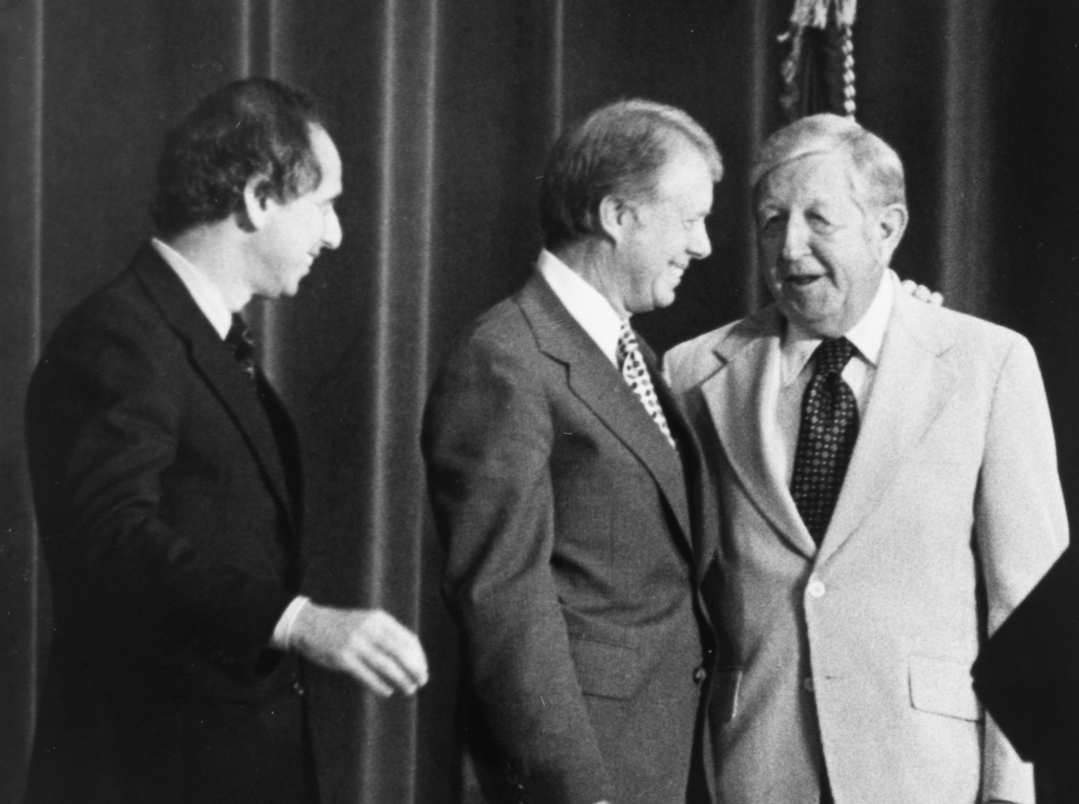 """President Jimmy Carter talks with retired TVA Board Chairman Aubrey Wagner on May 22, 1978, at the Civic Auditorium. At left is S. David Freeman who was named to succeed Wagner the week before. Speaking to about 2,500 TVA employees, Carter told them they can """"provide an alternative to the congested, polluted, and unstable super-cities of tomorrow."""""""
