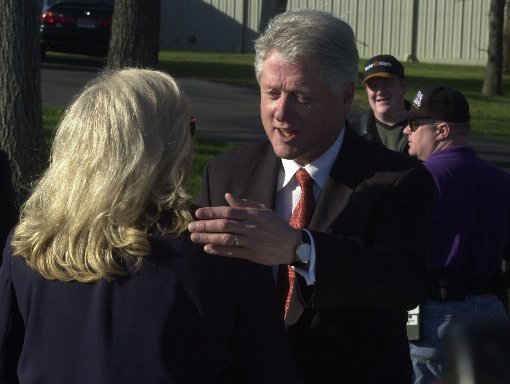 Former President Bill Clinton greets Gatlinburg resident Shayne Henderson at the Gatlinburg-Pigeon Forge Airport in Sevierville during a brief stop in East Tennessee.