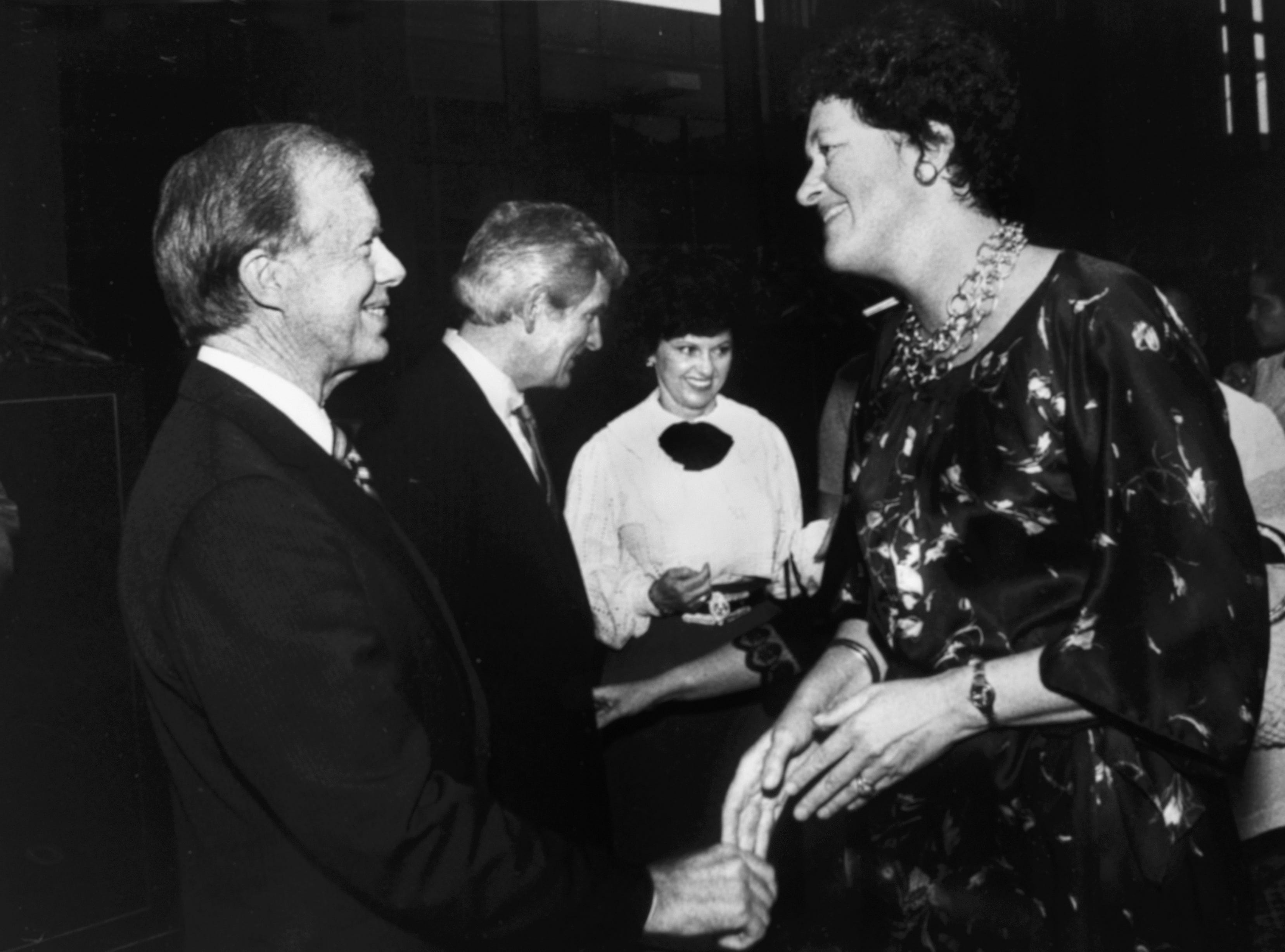 Former President Jimmy Carter meets Louisa Kennedy during a reception on Oct. 9, 1982, at United American Bank. Kennedy, whose husband, Mike Kennedy, was one of the 53 Iranian hostages, was in town for a Peace Day program at the World's Fair. In the background are bank President Jake Butcher and his wife, Sonya.