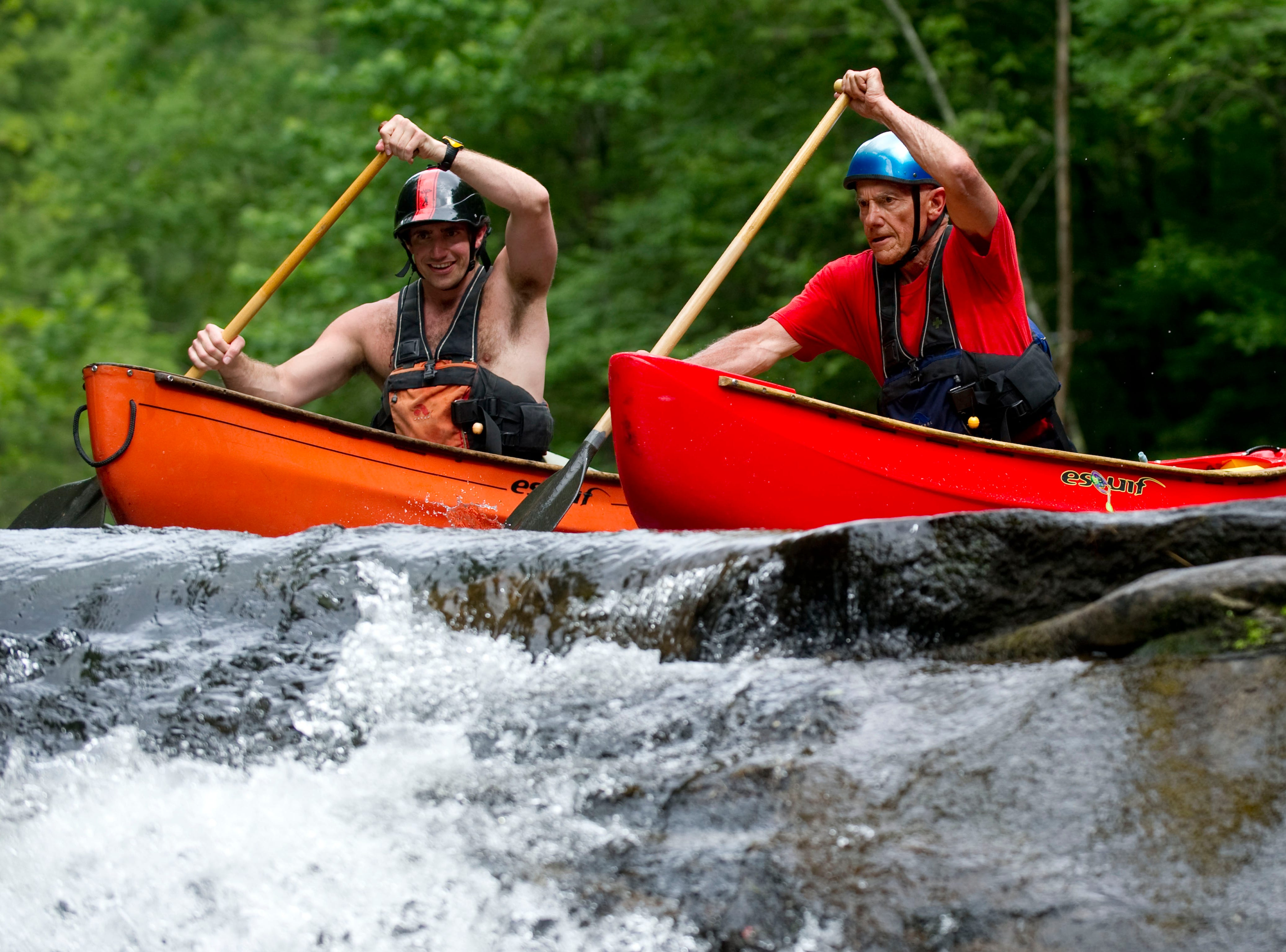Charlie Tombras, CEO of The Tombras Group, right, and his son Dooley Tombras canoe on the Tellico River on Sunday, June 10, 2012.