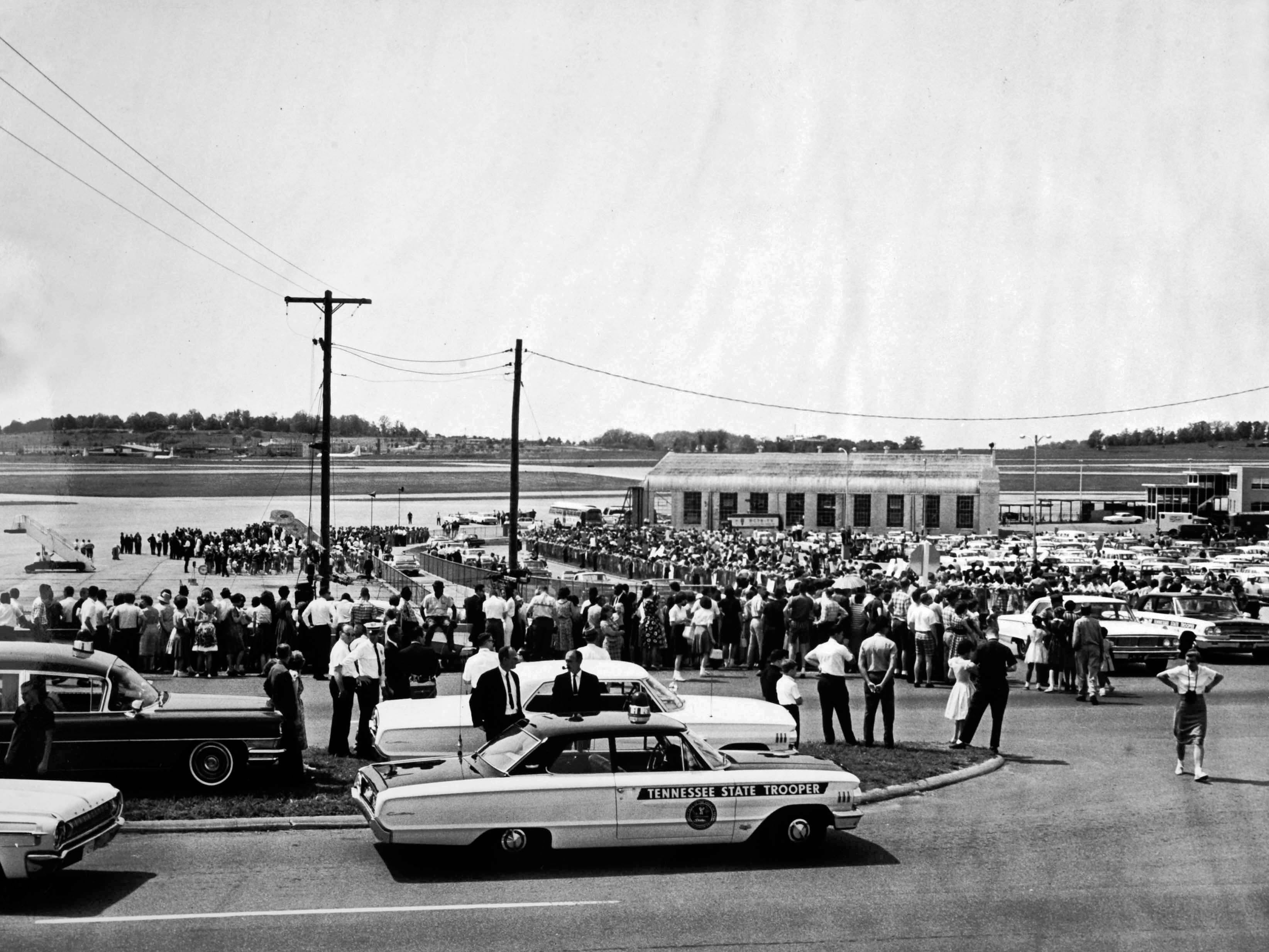"""In a May 7, 1964 photograph, a crowd gathers for the 3 p.m. arrival of President Lyndon B. Johnson at Municipal Airport. A News-Sentinel reporter interviewed Tony Hollingsworth, 17, who skipped school in Chattanooga to see the President. """"He walked over to me just like he knew who I was .... He had his hand out and people were just grabbing at it. He shook mine,"""" said Hollingsworth."""