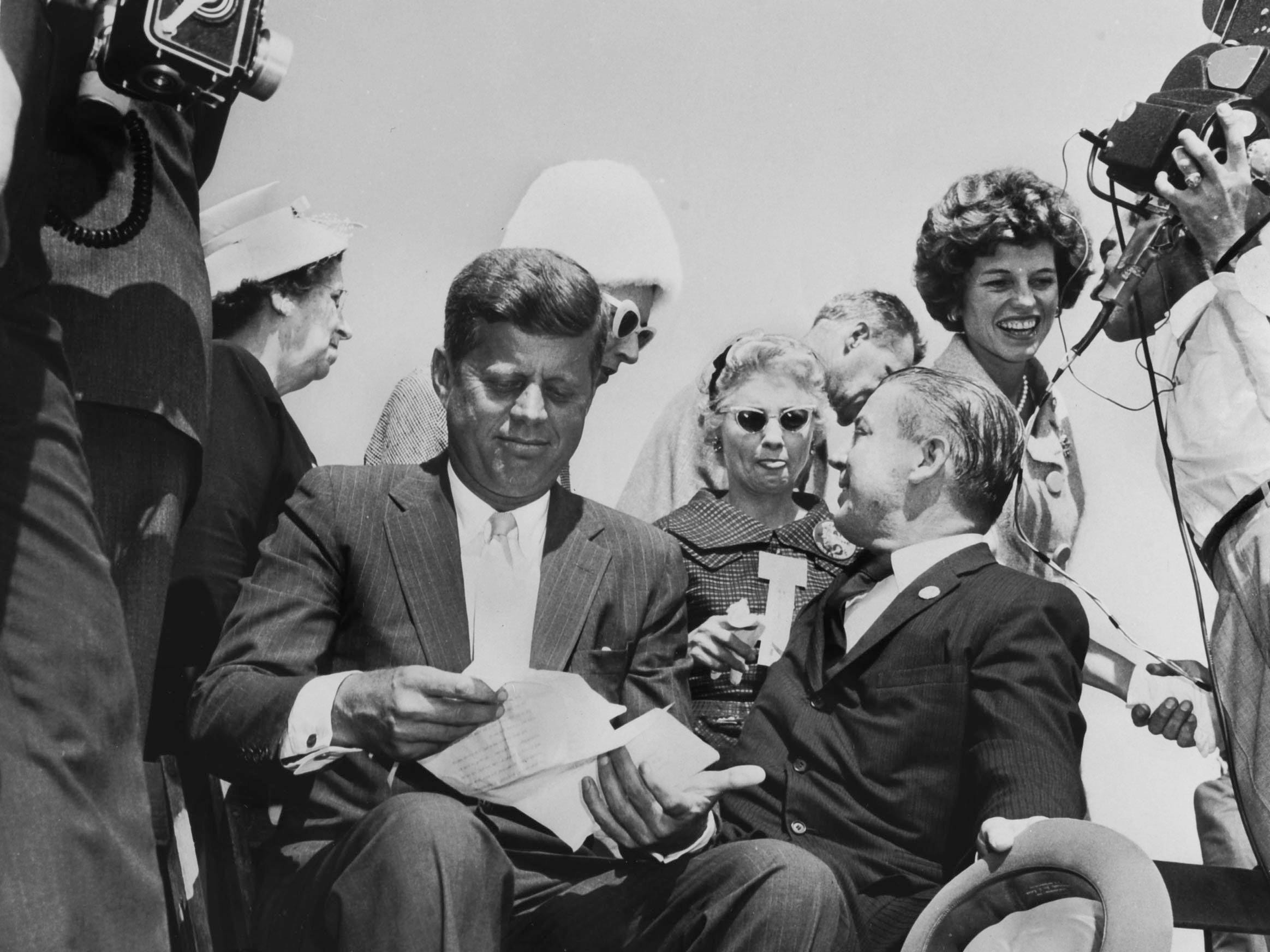 In a Sept. 21, 1960, photograph, Democratic Presidential nominee John F. Kennedy, with U.S. Rep. Joe L. Evins, prepares to speak during a campaign appearance at McGhee Tyson Airport. Standing at right is Kennedy's sister, Eunice Kennedy Shriver.