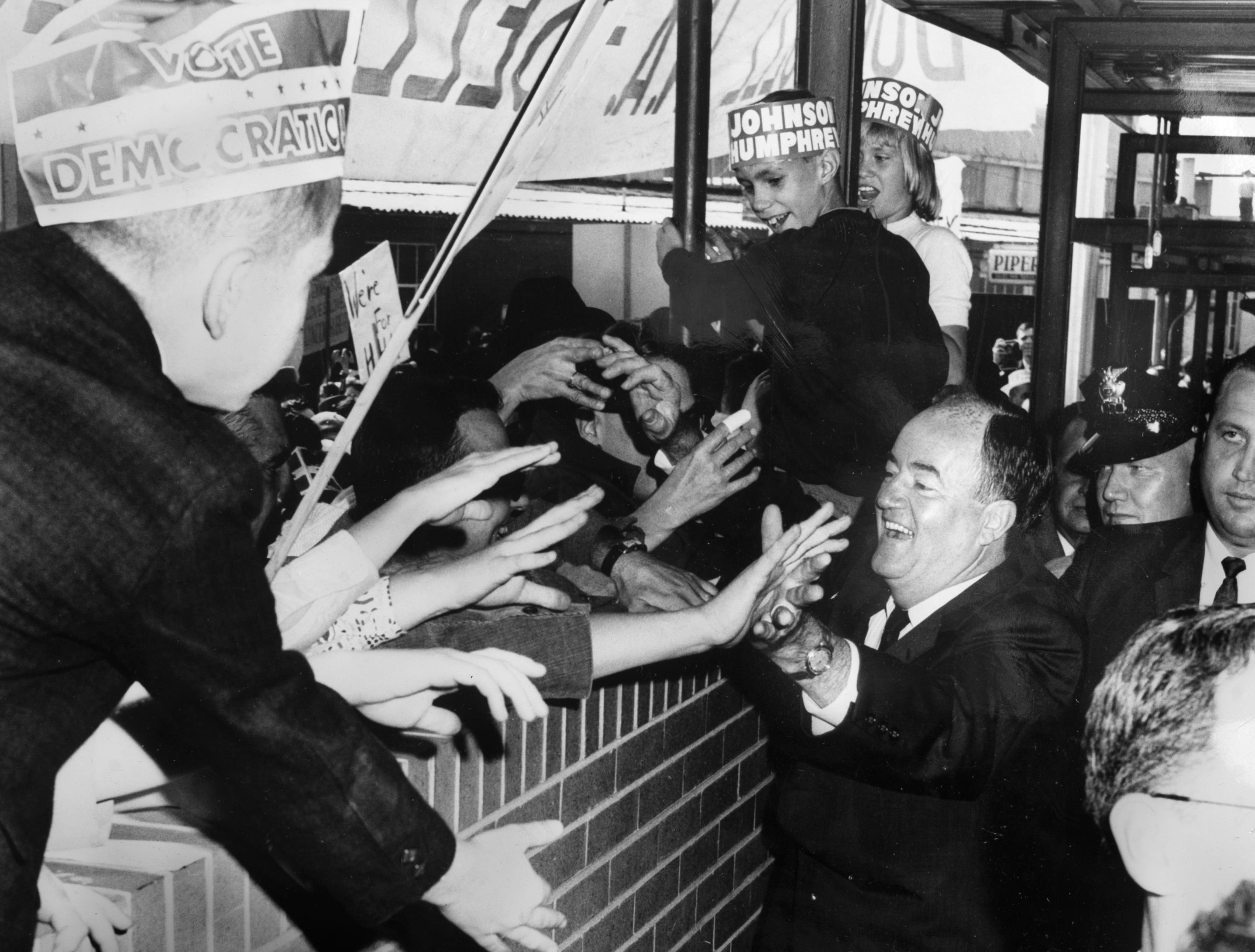 U.S. Sen. Humbert Humphrey campaigns for Vice President on Oct. 17, 1964, at Municipal Airport.
