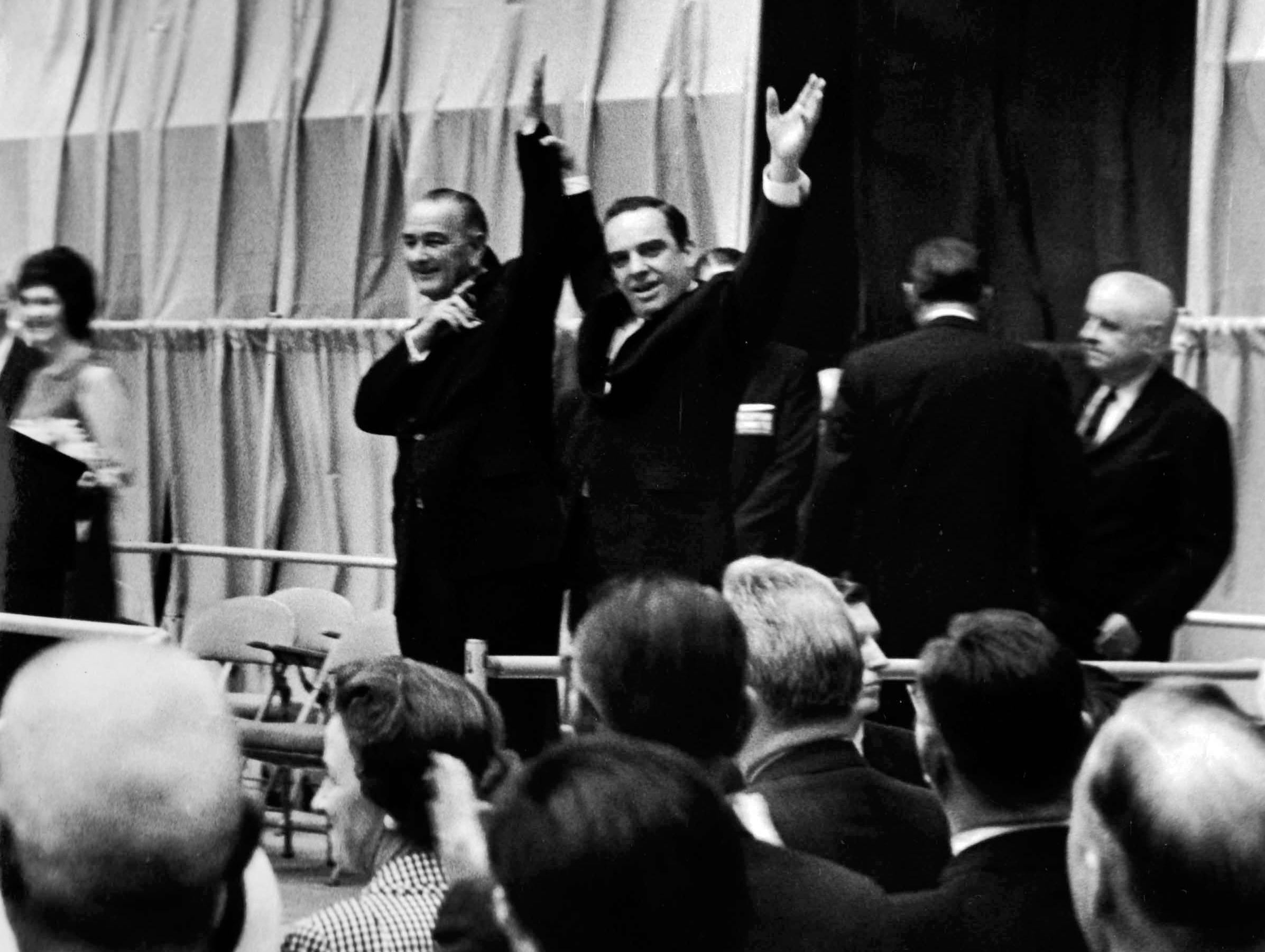 In a May 7, 1964 photograph, President Lyndon B. Johnson and Gov. Frank Clement acknowledge the crowd of 7,000 people who filled the Civic Coliseum for a rally.