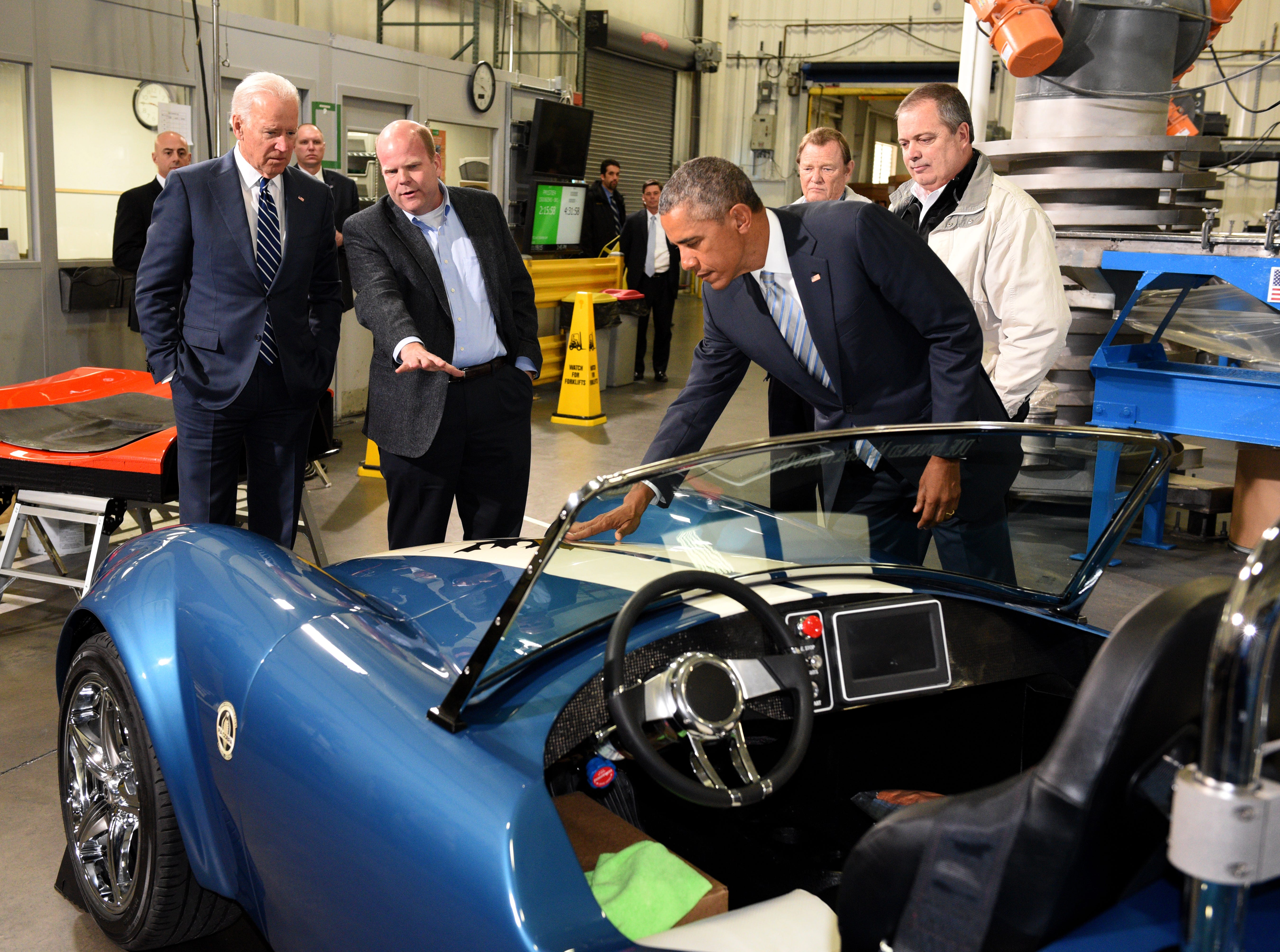 Lonnie Love of Oak Ridge National Laboratory, second from left, explains a 3D-printed Shelby Cobra to Vice President Joe Biden, left, and President Barack Obama at Techmer PM Friday, Jan. 9, 2015, in Clinton. At right is Tom Drye, managing Director at Techmer Engineered Solutions. (MICHAEL PATRICK/NEWS SENTINEL)