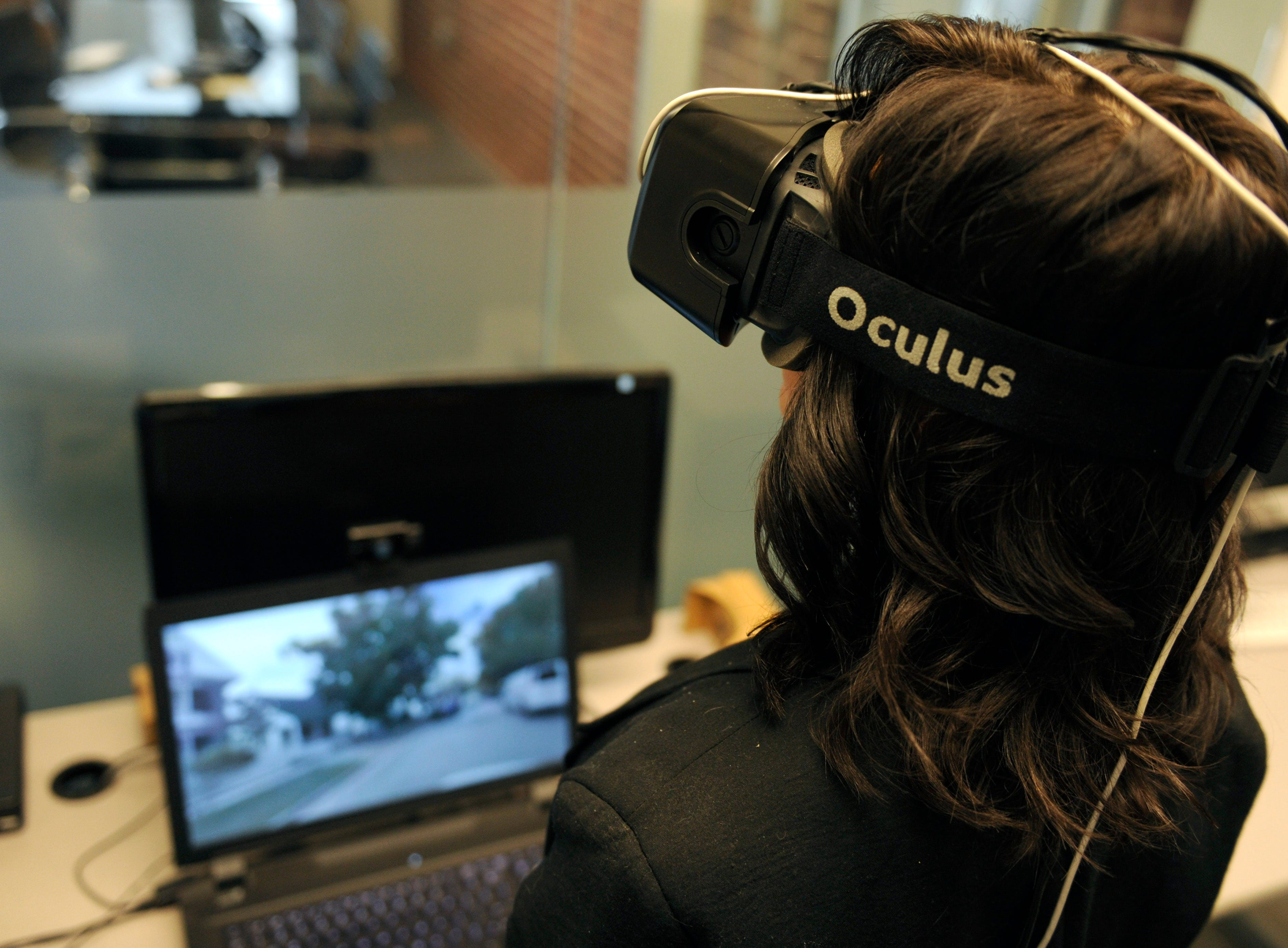 The Tombras Group executive assistant Krista Stevenson experiences the companies newly developed Virtual Reality Lab using Oculus Rift, Monday, Feb. 8, 2016.