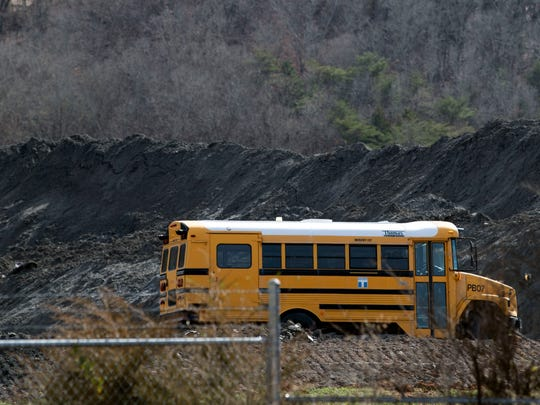 Mounds of coal ash can be seen near the Kids Palace Playground in Clinton, TN on Wednesday, February 13, 2019.