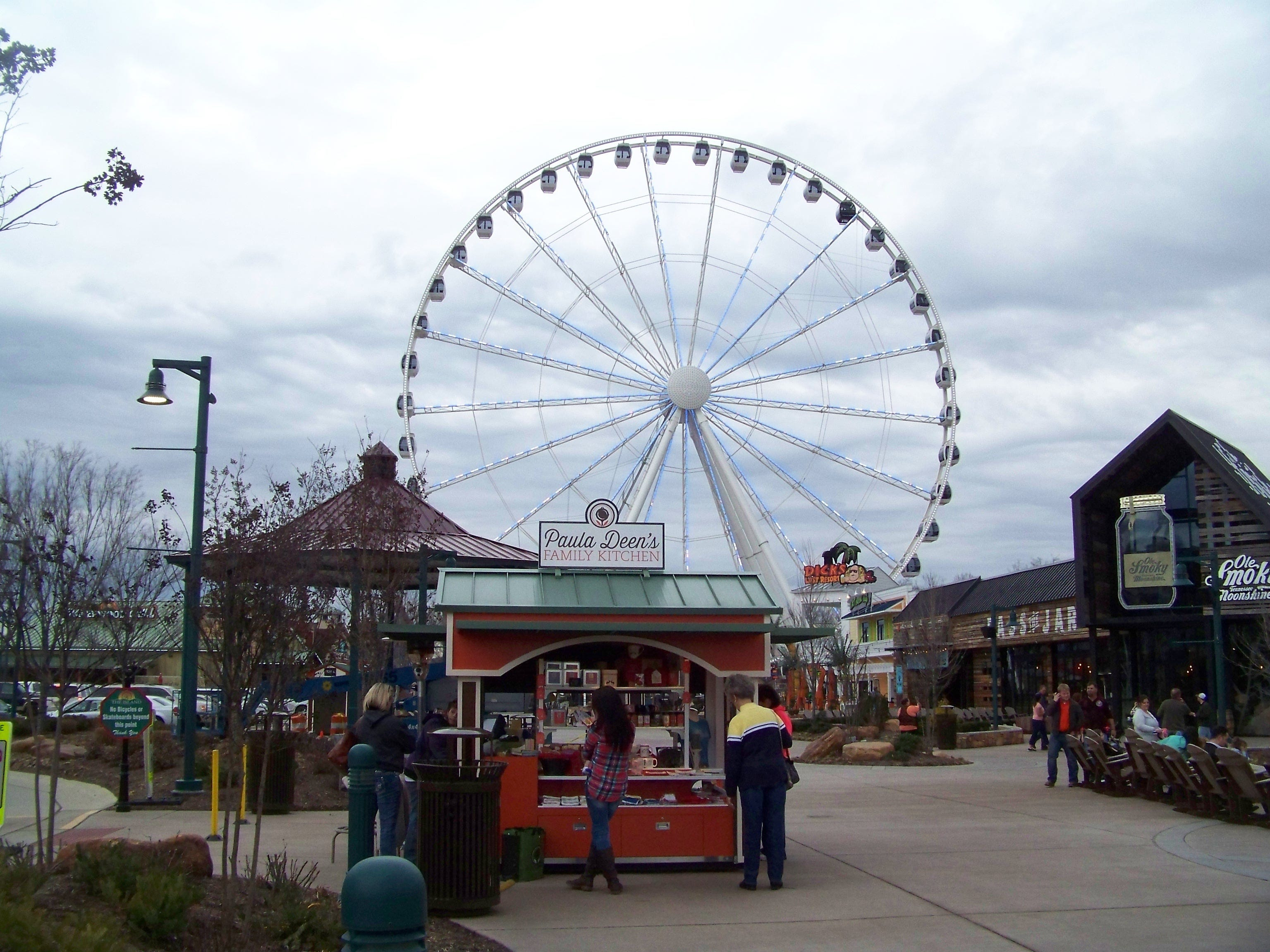 Paula Deen's Family Kitchen, under construction at The Island in Pigeon Forge, will allow diners to have a view of the 200-foot Ferris Wheel and the fountains. A booth selling Paula Deen merchandise sits across from the new restaurant.