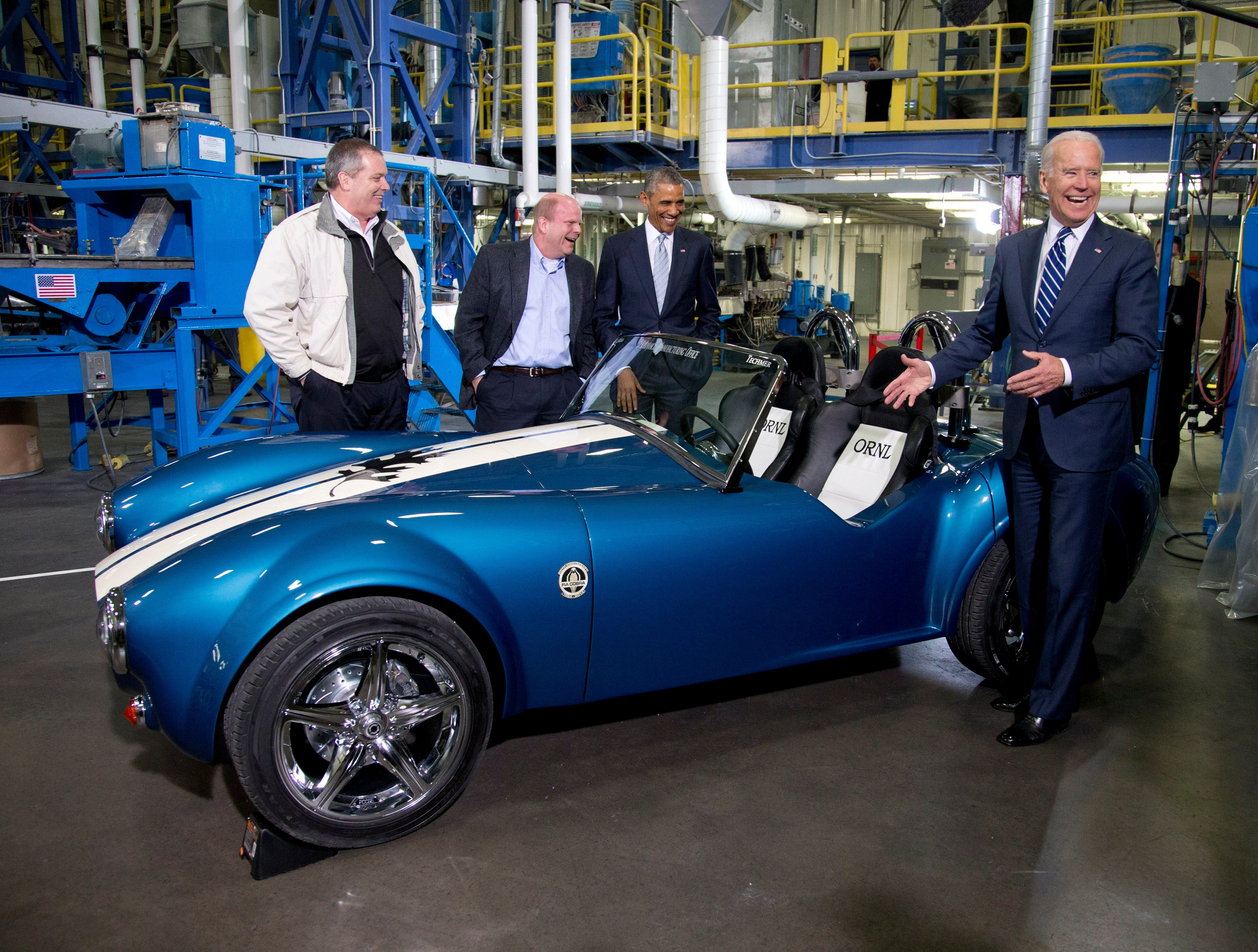 From left, Tom Drye, Managing Director of Techmer ES, Lonnie Love, Shelby Cobra 3D print designer and manufacturer at Oak Ridge National Lab, President Barack Obama, and Vice President Joe Biden admire a 3D printed Shelby Cobra, at Techmer PM, a plastic fabrication company, Friday, Jan. 9, 2015, in Clinton, Tenn., where the president talked about the administration's efforts to create new, good paying manufacturing jobs. (AP Photo/Carolyn Kaster)