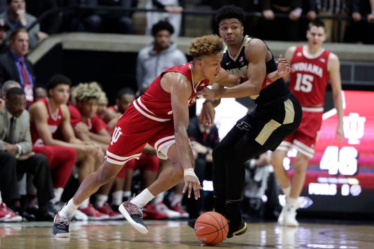 Indiana guard Romeo Langford (0) gets tied up with Purdue guard Nojel Eastern (20) during the second half of an NCAA college basketball game in West Lafayette, Ind., Saturday, Jan. 19, 2019. Purdue defeated Indiana 70-55.