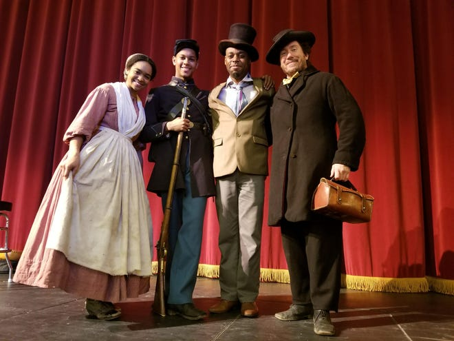 Actors performing in the Tippecanoe County Historic Association's Black History Month program pose on stage. A public version of the educational production will be offered for the first time on Tuesday, beginning at 7 p.m. at the Long Center for the Performing Arts.
