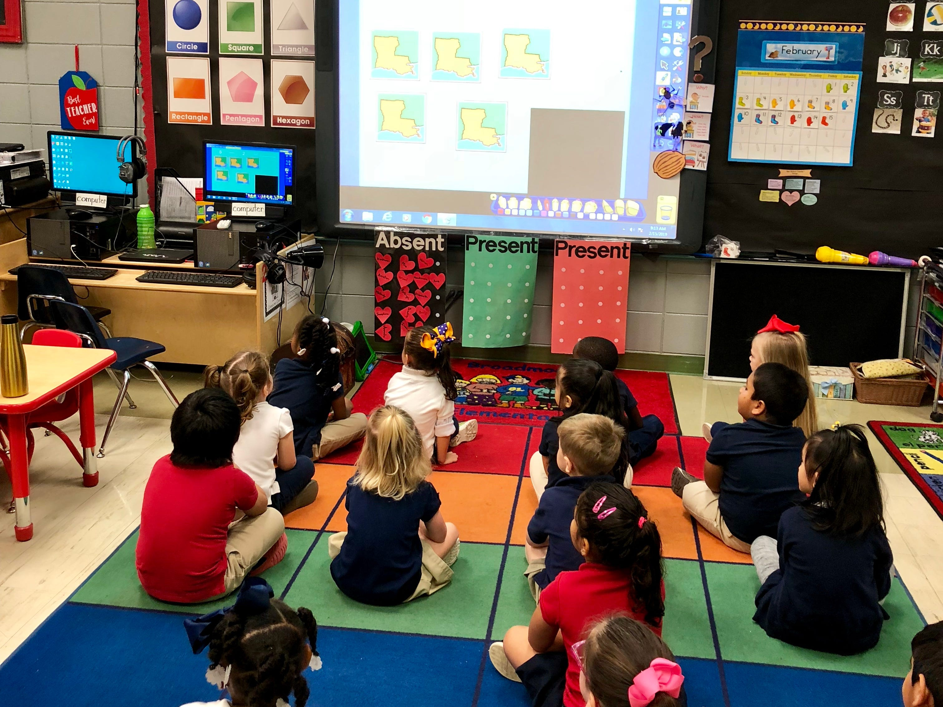 Students in Van Doole's pre-K class at Broadmoor Elementary practice adding and subtracting with Louisiana-related pictures on the smart board.