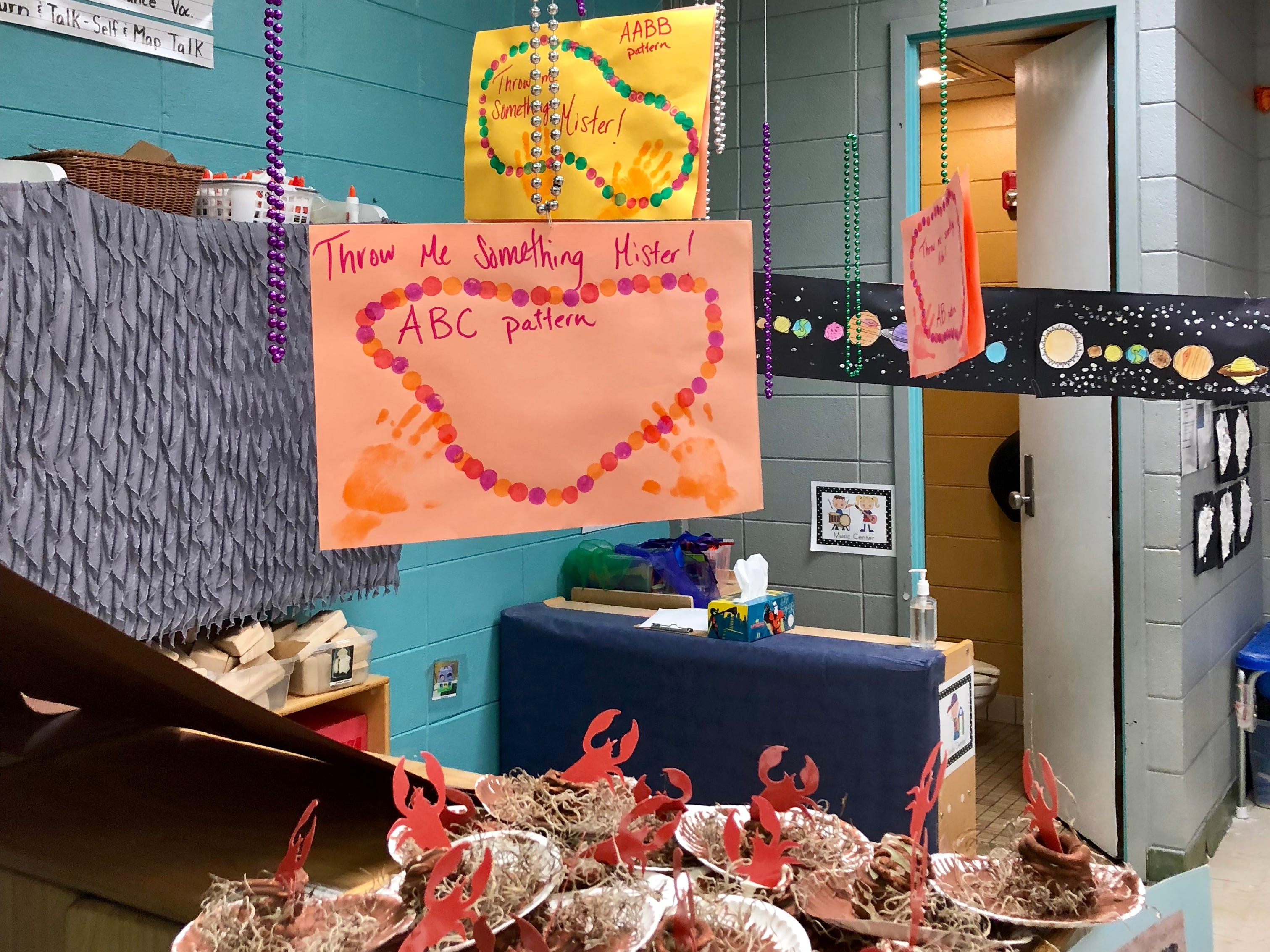 Pre-K students at Broadmoor Elementary worked on fine motor skills and patterns with class art projects related to Louisiana, like Mardi Gras beads and crawfish holes.
