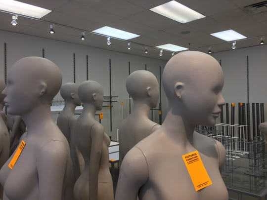 Mannequins and shelves are for sale at Charlotte Russe's outlet store in Tanger Outlets in Howell Township, Monday, Feb. 18, 2019. The store is liquidating its inventory and store fixtures before it closes.