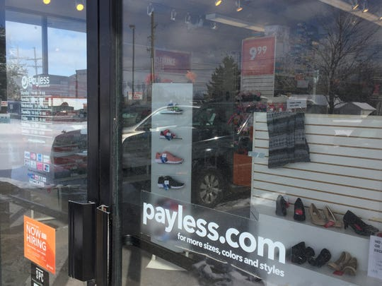 A look through the window of a Payless ShoeSource store in Genoa Township, shown Monday, Feb. 18, 2019, shows some of the inventory the store is selling before it closes.