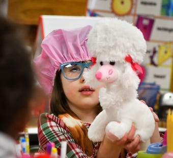 Kids dress like they're 100 years old on 100th day of school and collect hundreds of non-perishables for food bank.