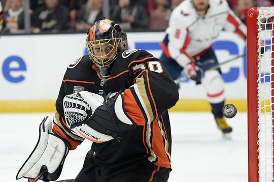 Anaheim Ducks goaltender Ryan Miller deflects a shot during the third period of an NHL hockey game against the Washington Capitals Sunday, Feb. 17, 2019, in Anaheim, Calif. The Ducks won 5-2.