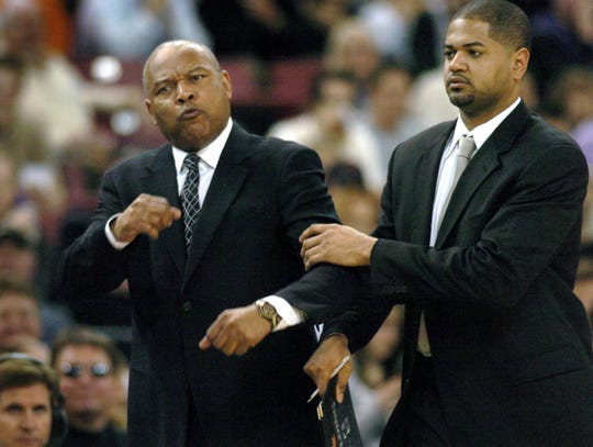 Charlotte Bobcats assistant coach John-Blair Bickerstaff, right, holds back his father, coach Bernie Bickerstaff, after the elder Bickerstaff was called for a technical foul in the third quarter of an NBA basketball game against the Sacramento Kings in Sacramento, Calif., Wednesday, Feb. 28, 2007. The Kings won 135-120. (AP Photo/Steve Yeater)
