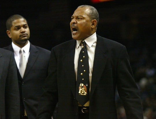 Charlotte Bobcats coach Bernie Bickerstaff, right, yells at an official as his son and assistant coach, John-Blair Bickerstaff, keeps him off the court after the elder Bickerstaff was ejected in the second half of the game against the Philadelphia 76ers at the Charlotte Coliseum in Charlotte, N.C., on Wednesday, Jan. 19, 2005.  Philadelphia defeated Charlotte 107-105. (AP Photo/Nell Redmond)