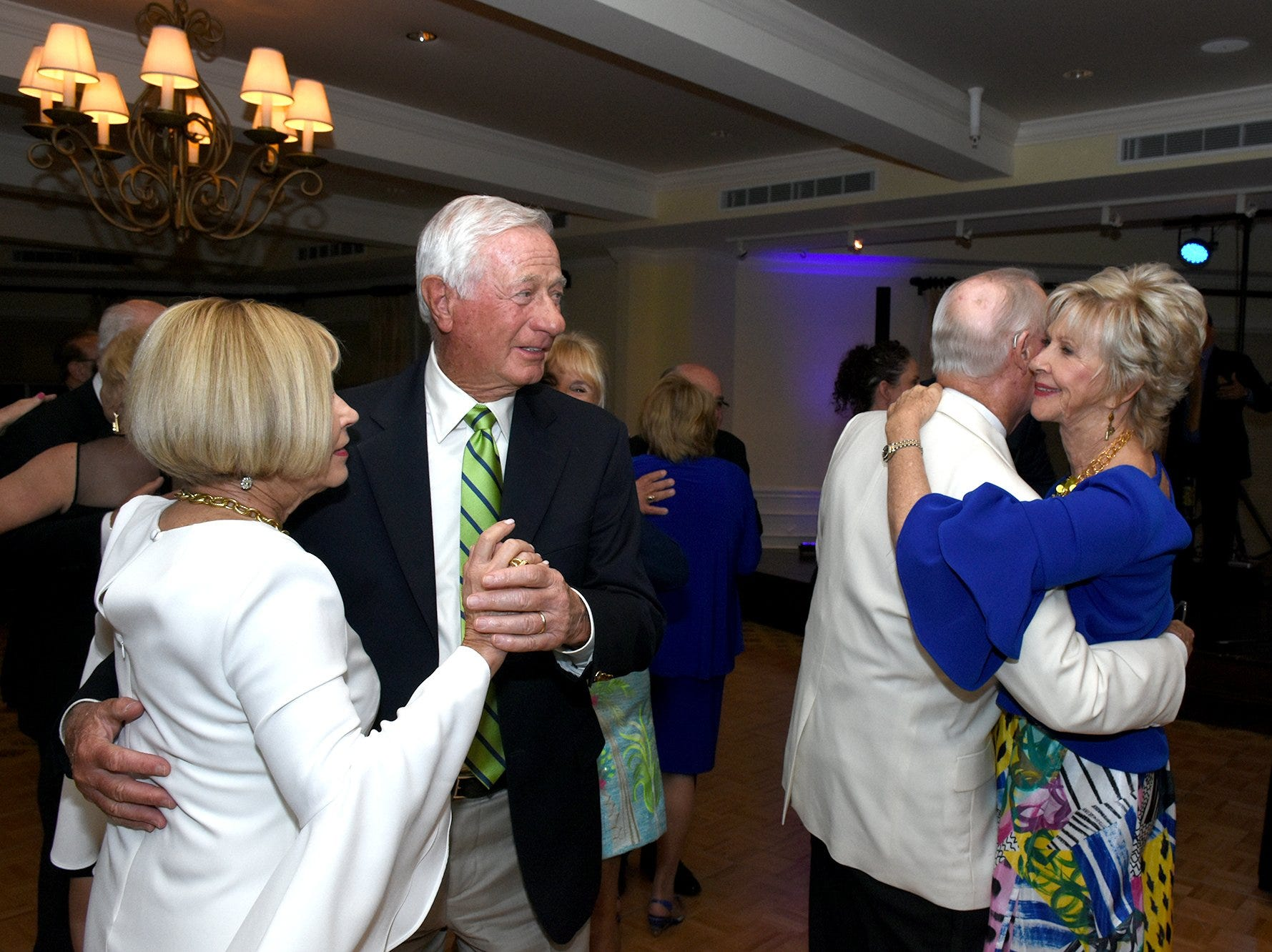 """Bob Genirs and Corinne Sloan, left, dance, along with honorees John and Emily James. The Marco Island Cdenter for the Arts held """"Celebrate Art by the Sea,"""" their annual gala, Saturday evening at the Island Country Club."""