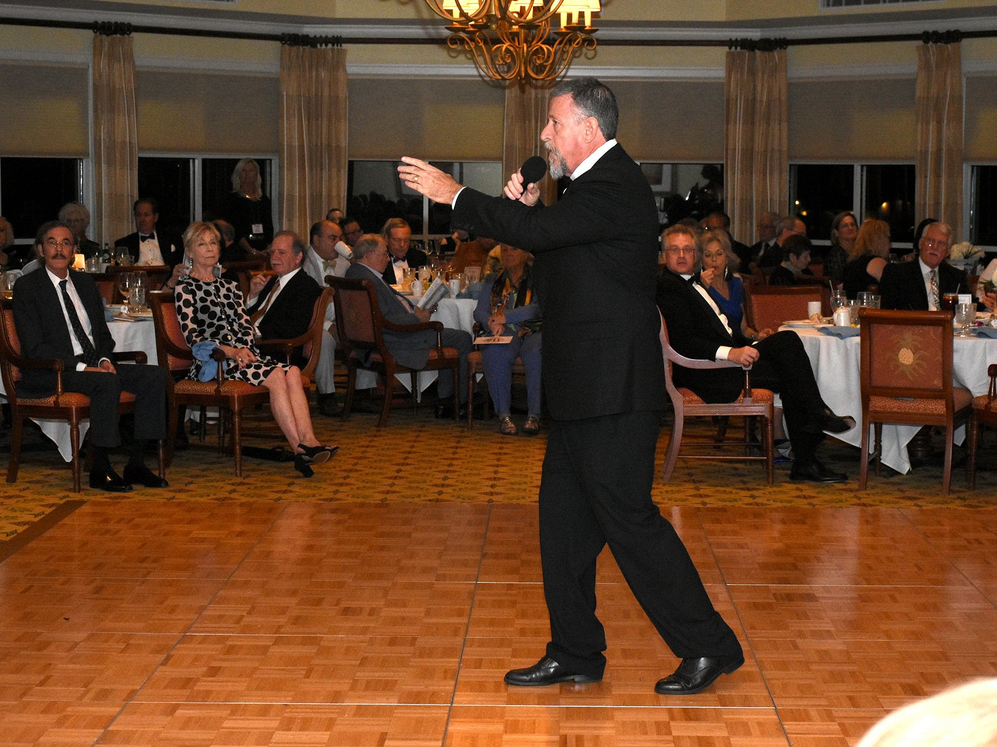 """Auctioneer Kevin Benson takes bids on a gourmet culinary excursion to New Orleans. The Marco Island Cdenter for the Arts held """"Celebrate Art by the Sea,"""" their annual gala, Saturday evening at the Island Country Club."""