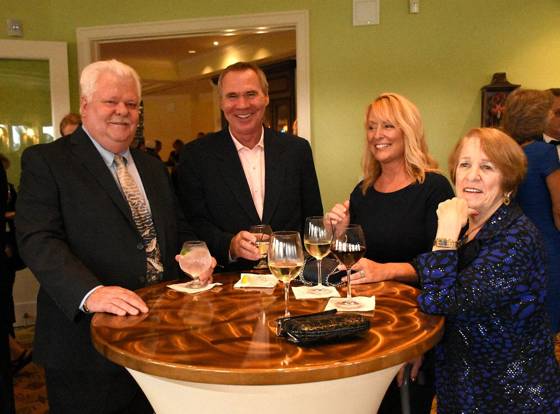 """Past president Ken Stroud, left, with Bruce and Monica Noel, and Lisa Hammond. The Marco Island Cdenter for the Arts held """"Celebrate Art by the Sea,"""" their annual gala, Saturday evening at the Island Country Club."""