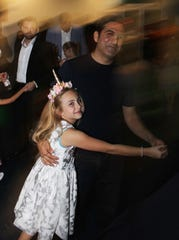 Memo Vatansever dances with daughter Ayla.