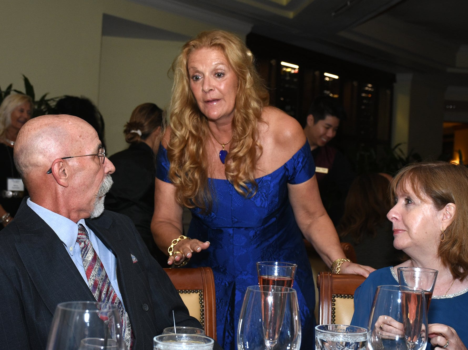 """Gala chair Kim Porter, center, talks with guests. The Marco Island Cdenter for the Arts held """"Celebrate Art by the Sea,"""" their annual gala, Saturday evening at the Island Country Club."""