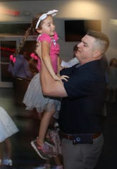 Steve Conner and daughter Emerson move to the music.
