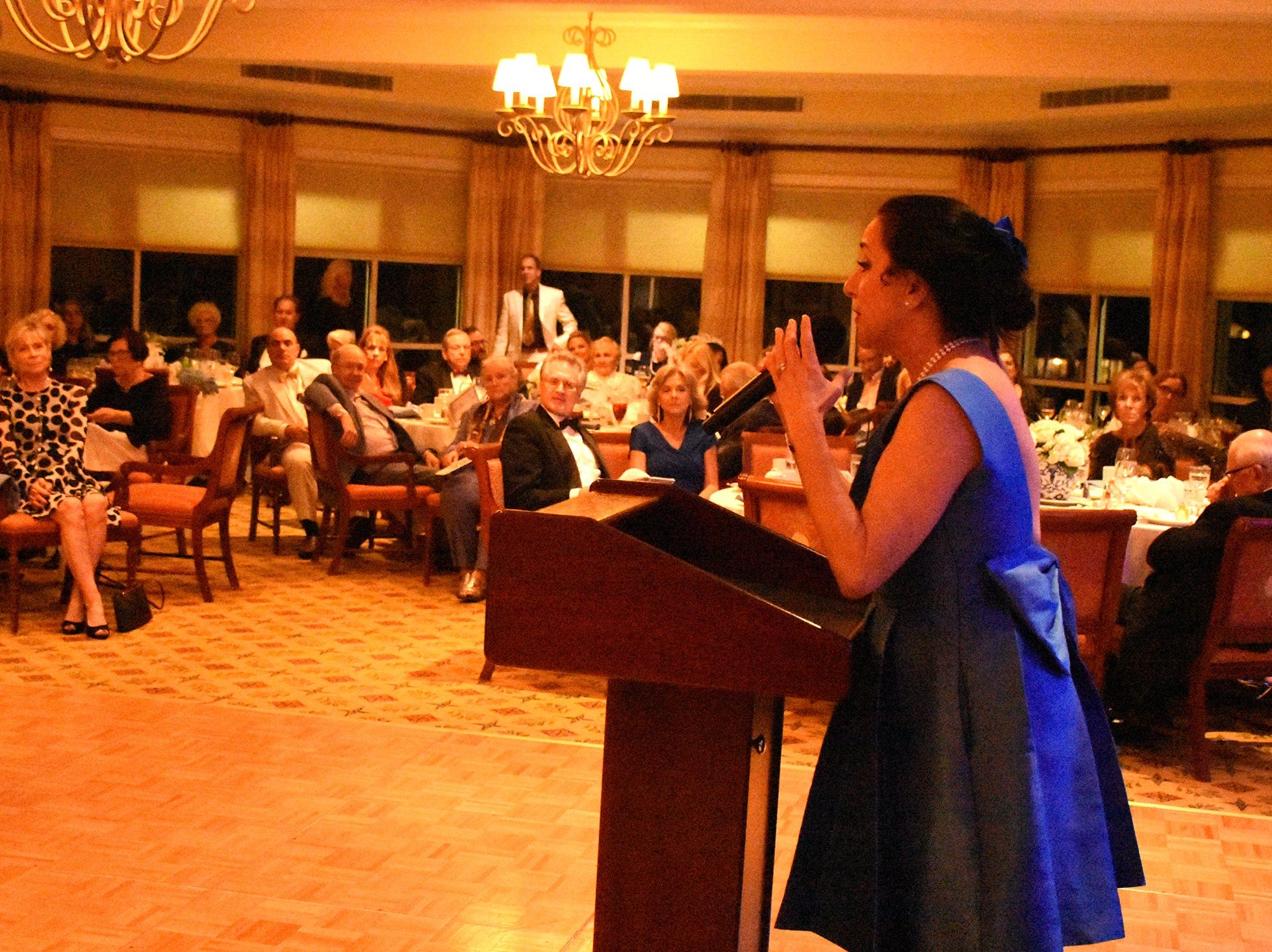 """Executive director Hyla Crane pitches for the audience's generosity in a """"cash call."""" The Marco Island Cdenter for the Arts held """"Celebrate Art by the Sea,"""" their annual gala, Saturday evening at the Island Country Club."""
