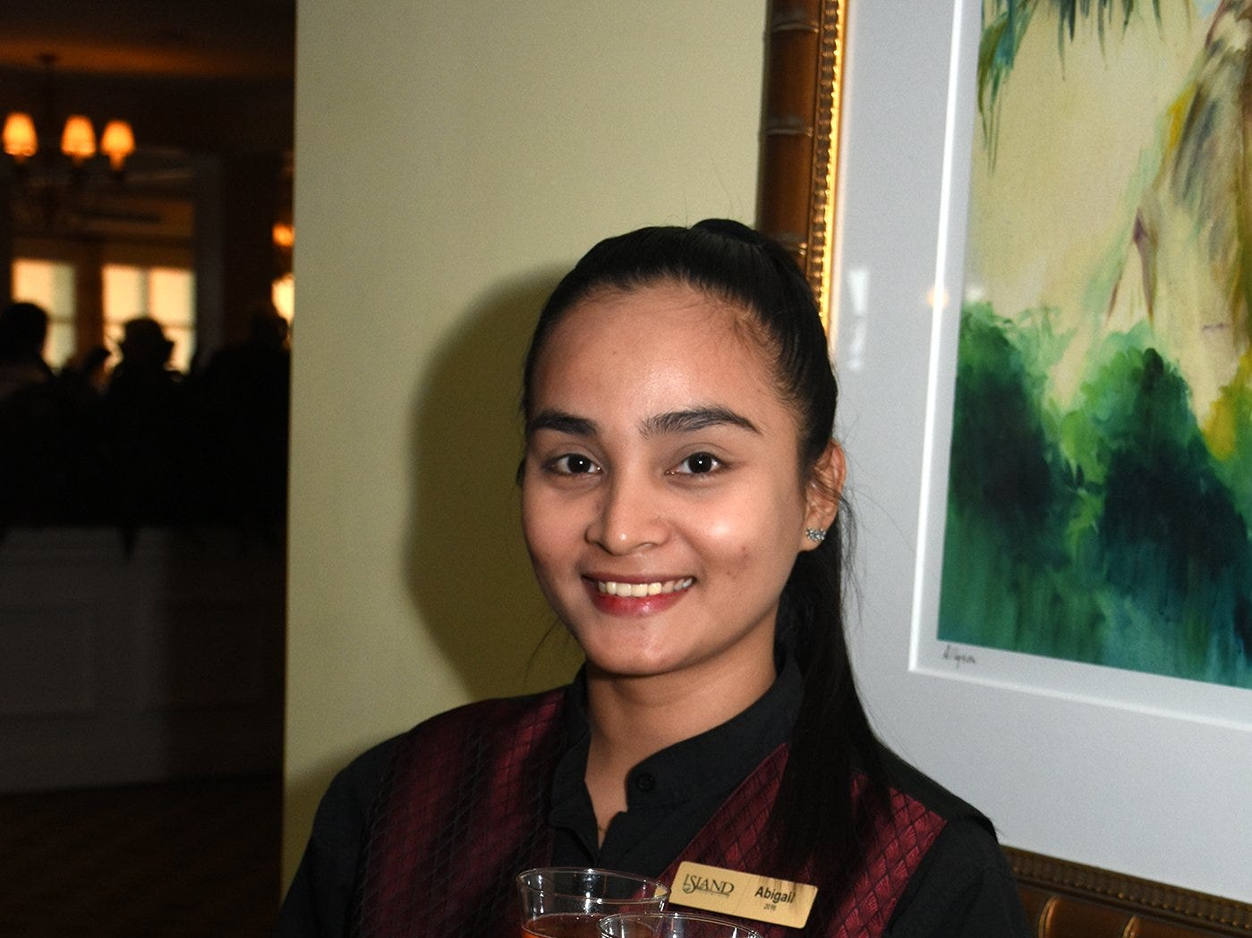 """Server Abigail passes out Folktale sparkling rose, from the gala's featured winery. The Marco Island Cdenter for the Arts held """"Celebrate Art by the Sea,"""" their annual gala, Saturday evening at the Island Country Club."""