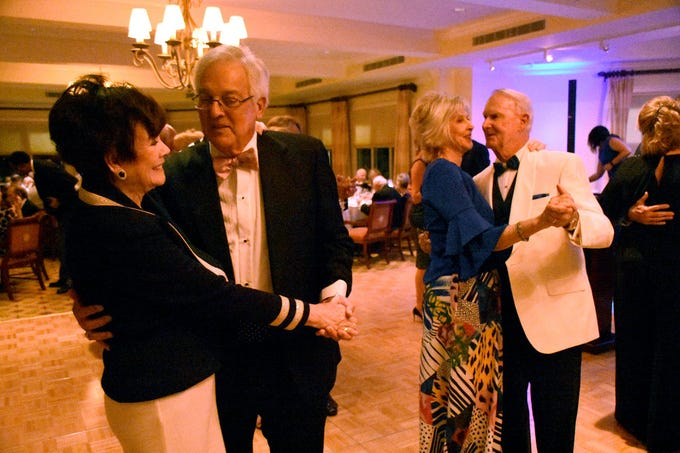 """Past president Rosemary Wick and Mike Wick, left, dance, along with honorees John and Emily James. The Marco Island Cdenter for the Arts held """"Celebrate Art by the Sea,"""" their annual gala, Saturday evening at the Island Country Club."""