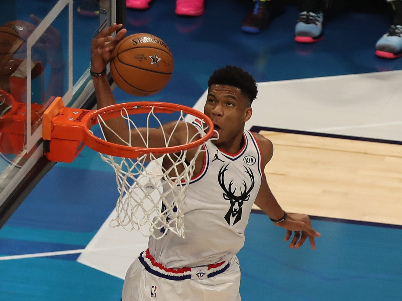 Giannis Antetokounmpo of the Milwaukee Bucks approaches the rim for one of his many dunks on Sunday night.
