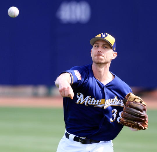 Brewers non-roster invitee Josh Tomlin works out during spring training drills Sunday  in Phoenix, Arizona. Photo/Roy Dabner / for the Milwaukee journal Sentinel