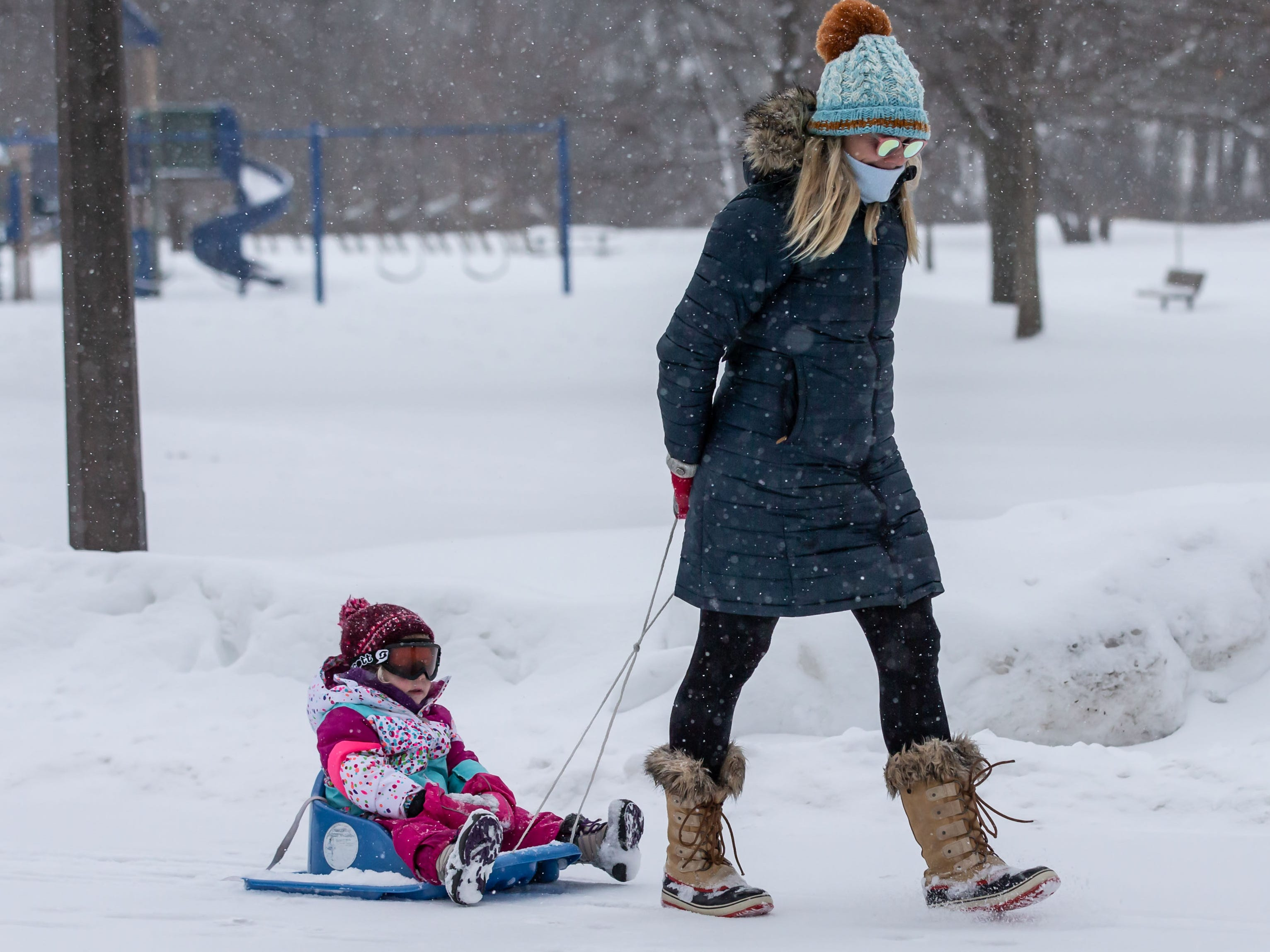 Brynn Dux of Wauwatosa and her 2-year-old daughter, Andi, enjoy a nature hike during the Winter Wonderland Family Event at Hoyt Park in Wauwatosa on Sunday. The free event featured guided nature hikes, winter-themed activities, crafts, movies, marshmallow toasting and more.