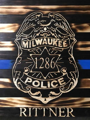 Trevor Deboer is putting together a fundraiser to help fallen police officer Matthew Rittner's family. This image will be part of a memorial to Rittner at the Feb. 23. event.