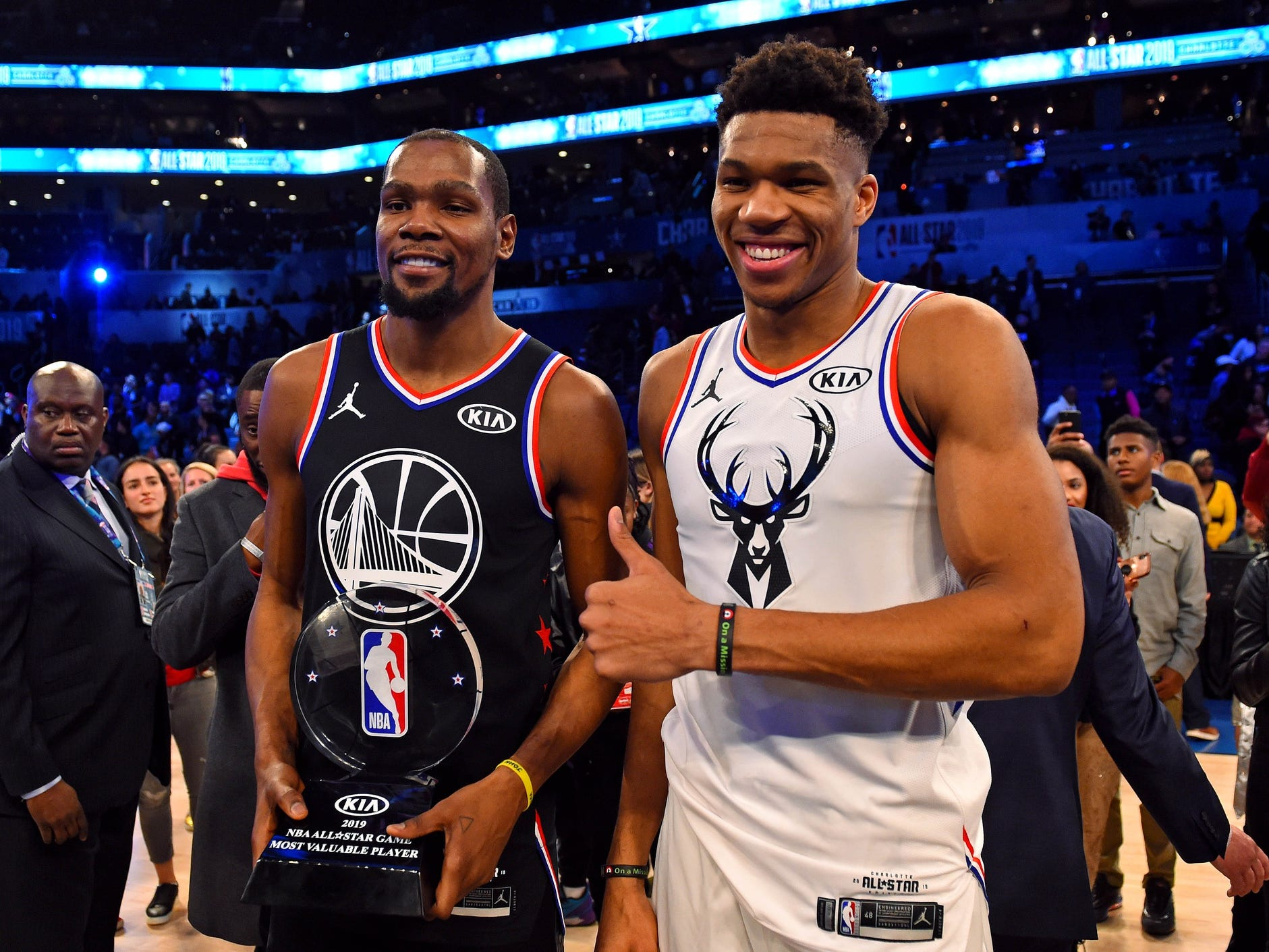 Giannis Antetokonumpo  stands with Kevin Durant after Durant is presented with the NBA All-Star Game MVP trophy.